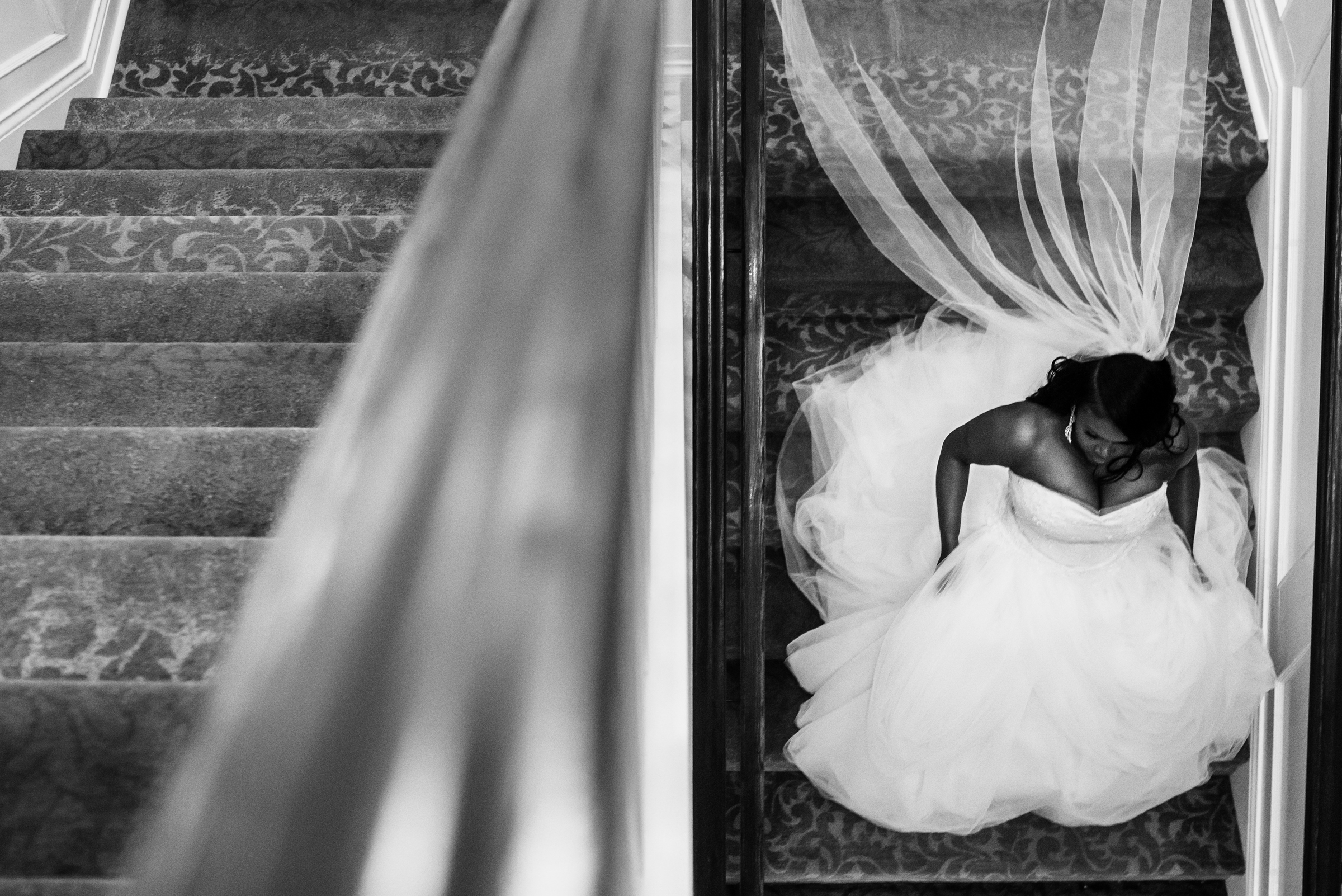 Bride descending stairs reflected - photo by Ashleigh Bing Photography