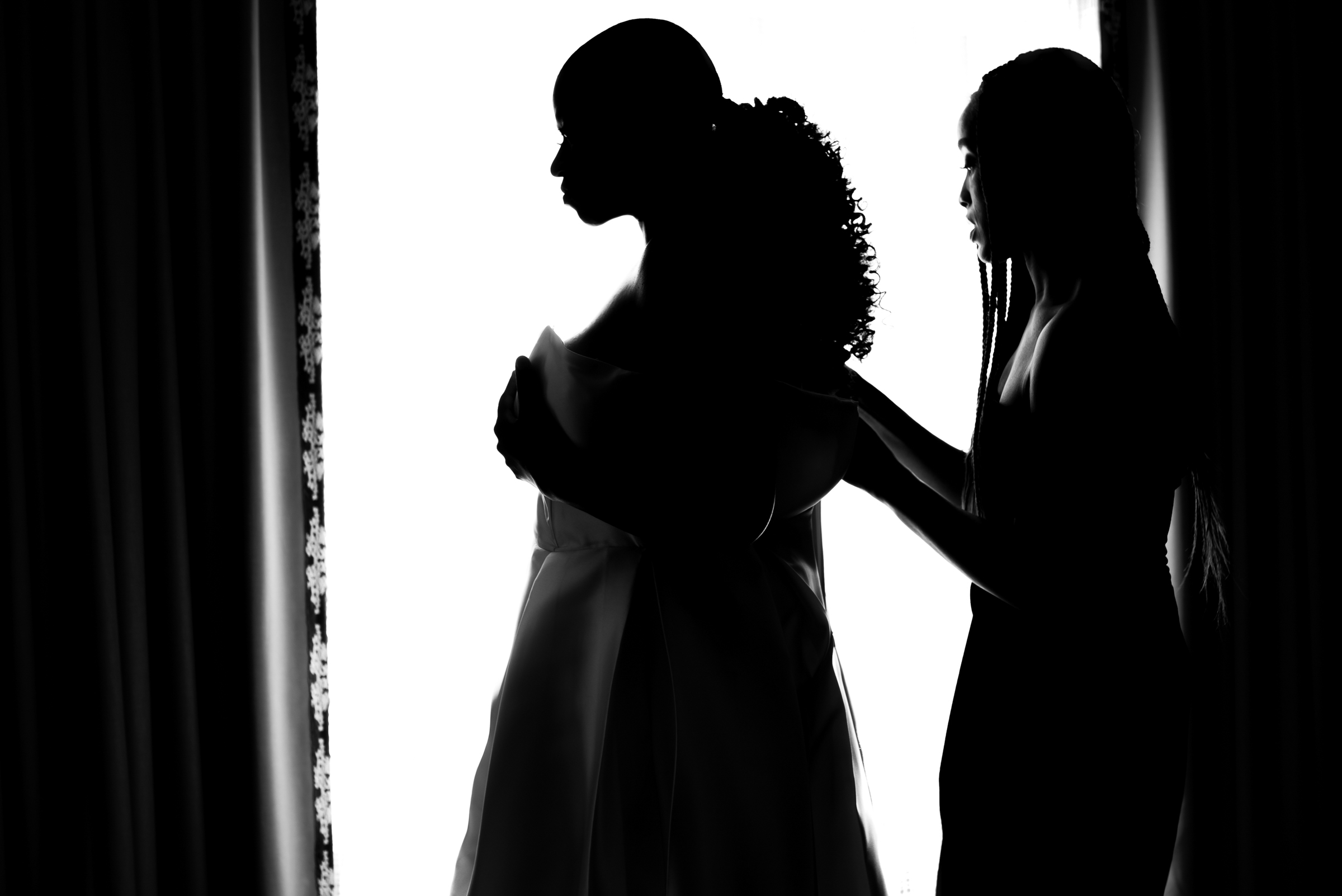 Profile silhouette of buttoning up the bridal gown - photo by Ashleigh Bing Photography