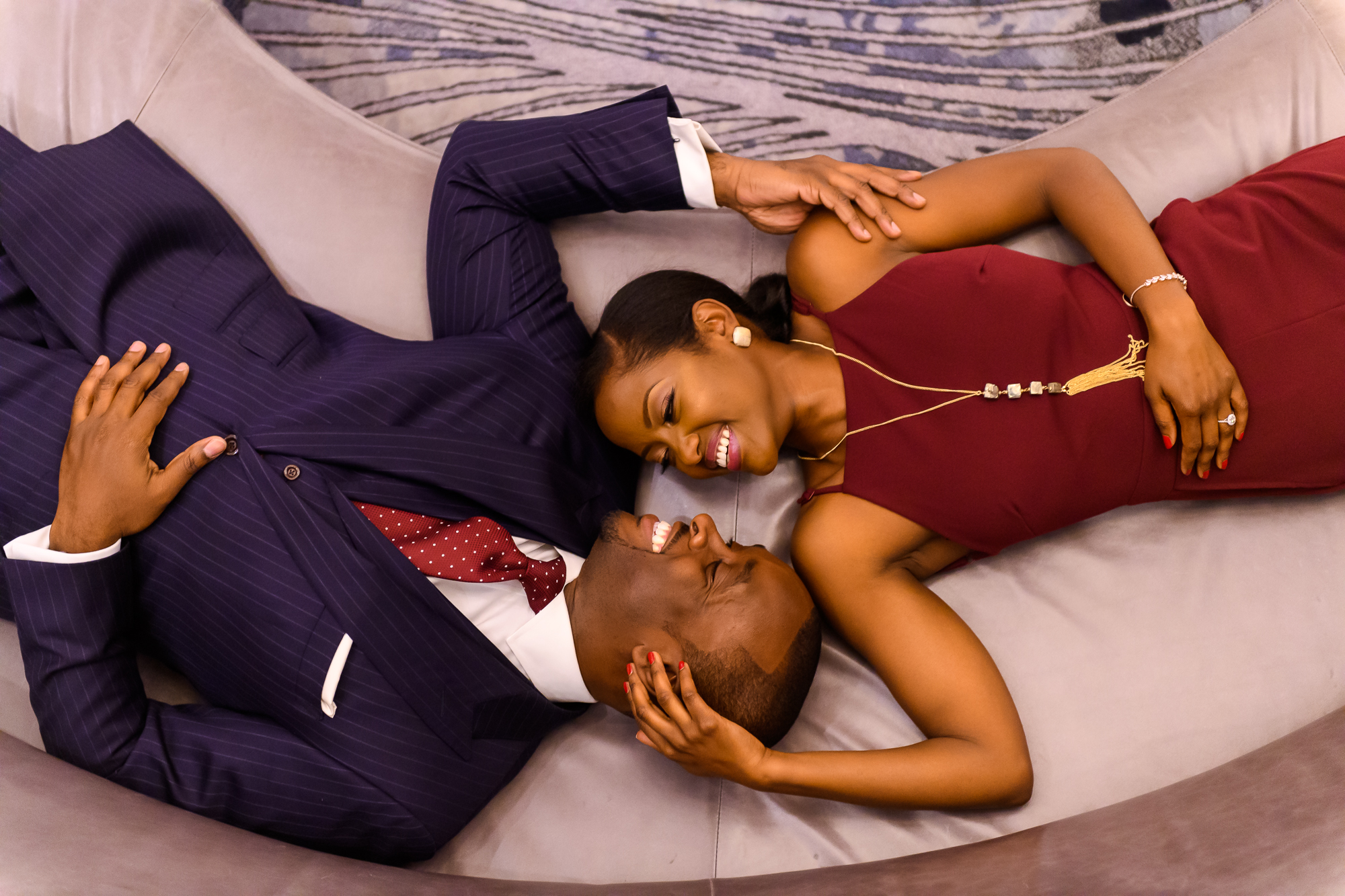 Aerial view of couple lying on couch - photo by Christopher Jason Studios