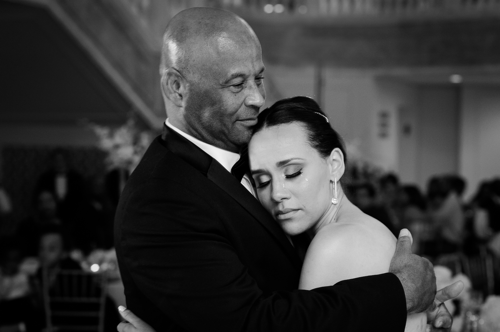 Bride embraces her father on dance floor - photo by Christopher Jason Studios