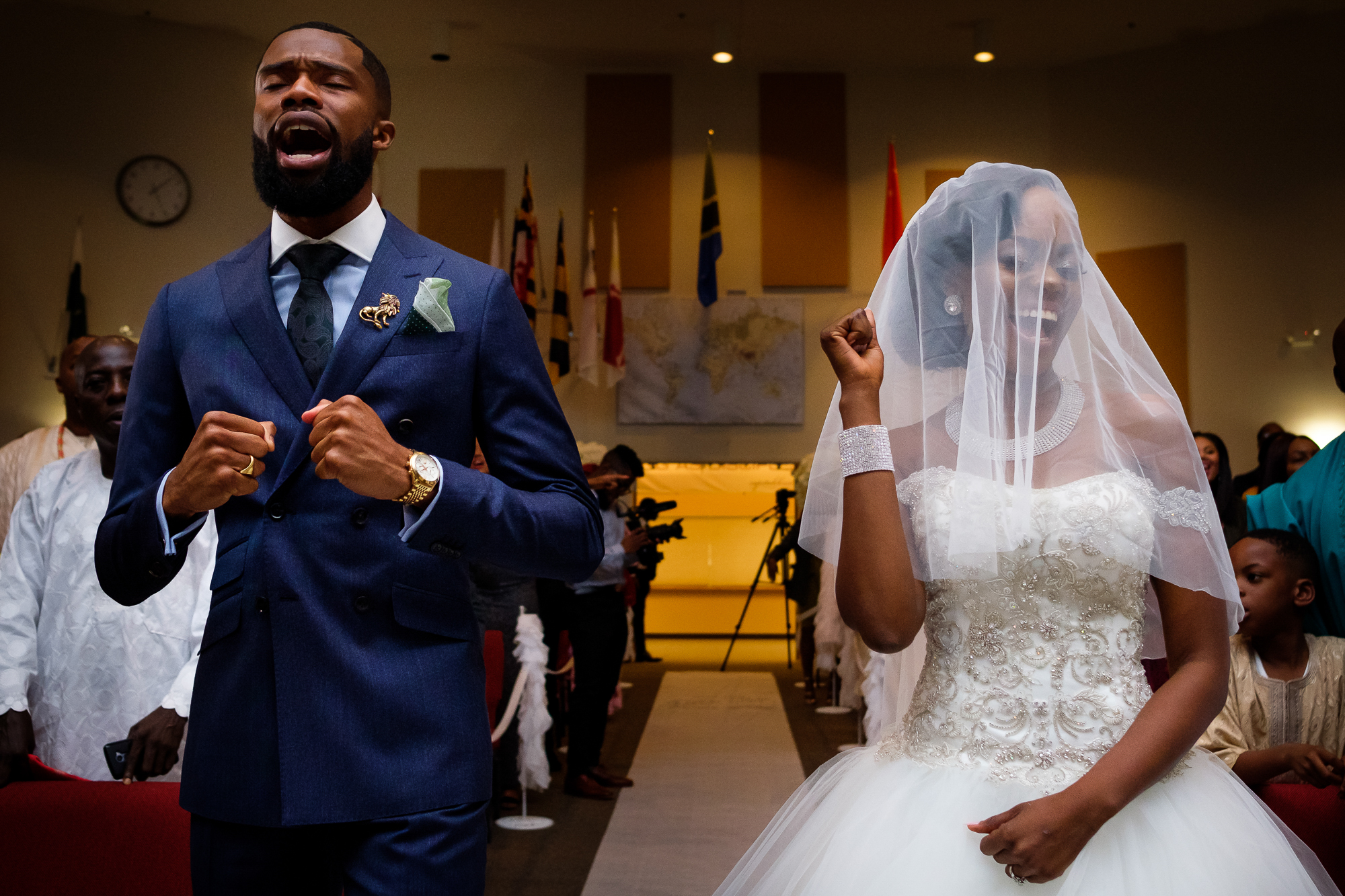 Couple singing gospel during church ceremony - photo by Christopher Jason Studios