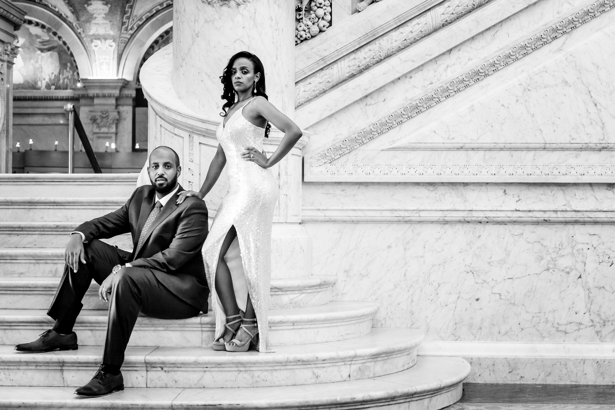 Elegant wedding portrait of groom and bride with slit silk gown - photo by Christopher Jason Studios