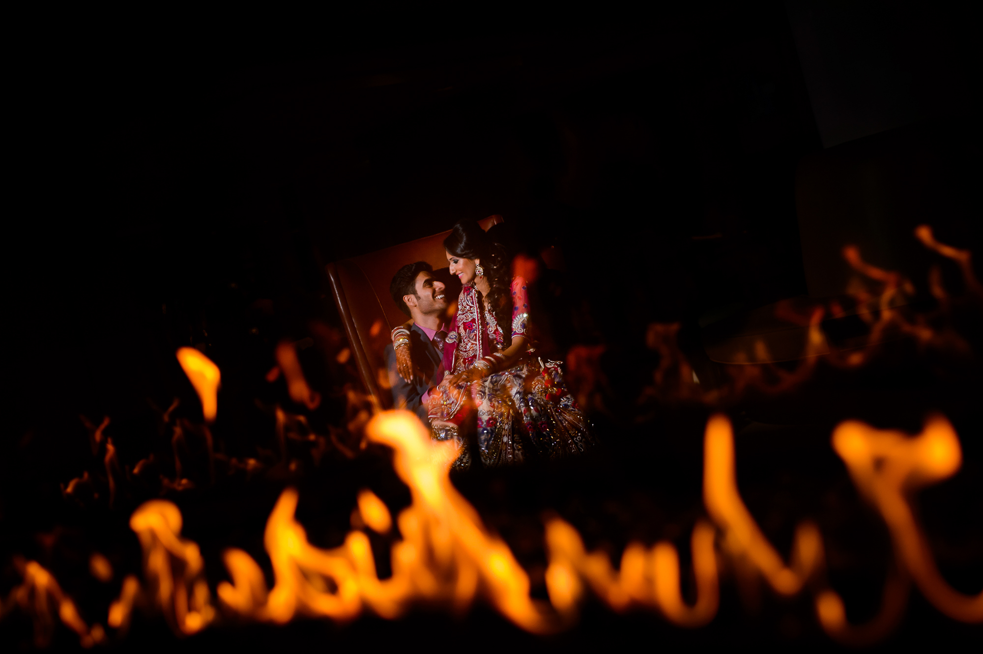 Indian couple photographed through flames at The Park Chateau New Jersey by Christopher Jason Studios