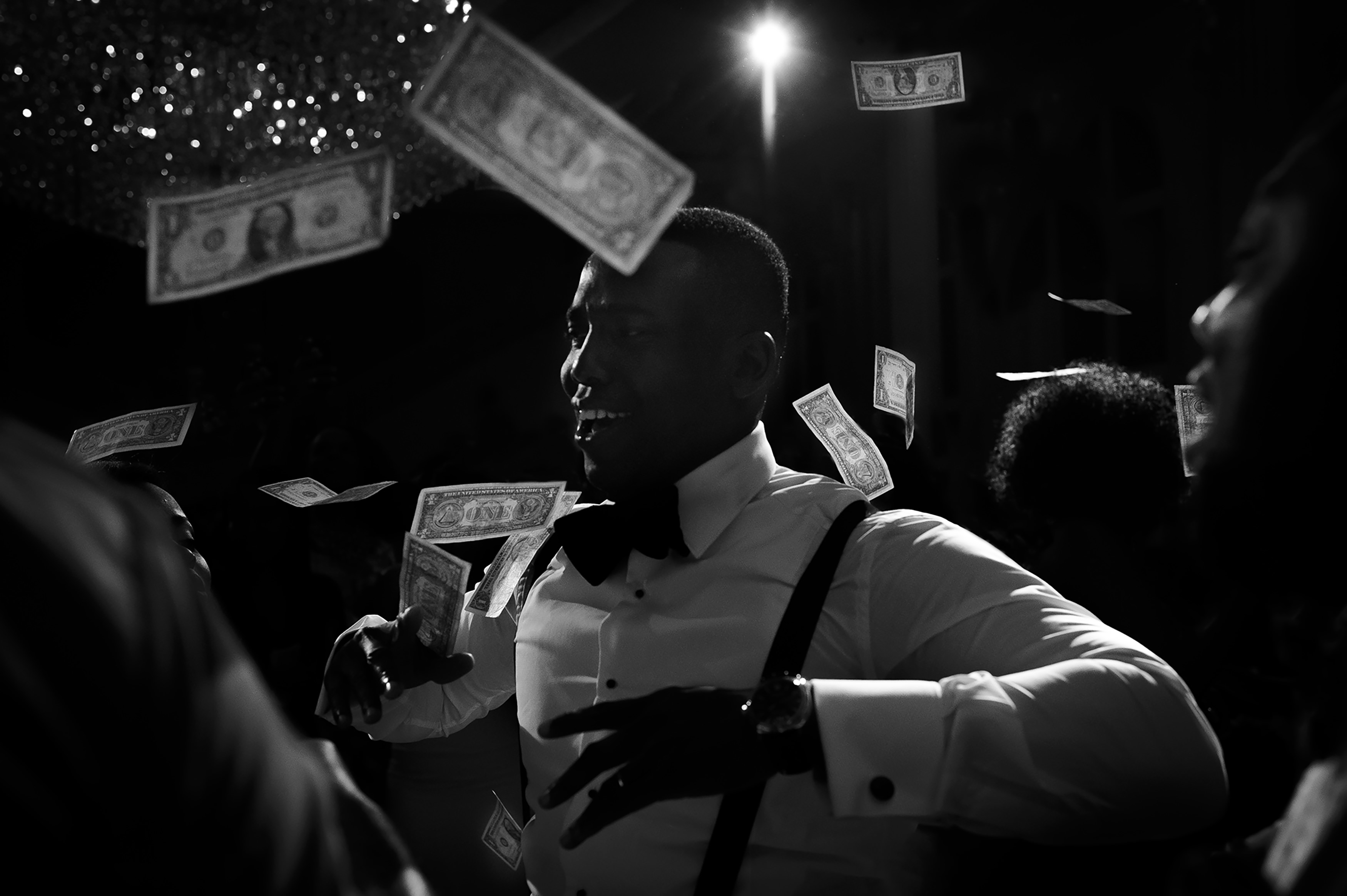 Money dance with spotlight - photo by Christopher Jason Studios