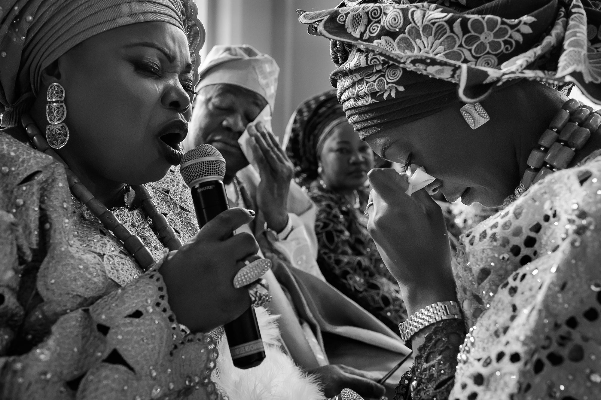 Nigerian parents pray for bride during ceremony - photo by Christopher Jason Studios
