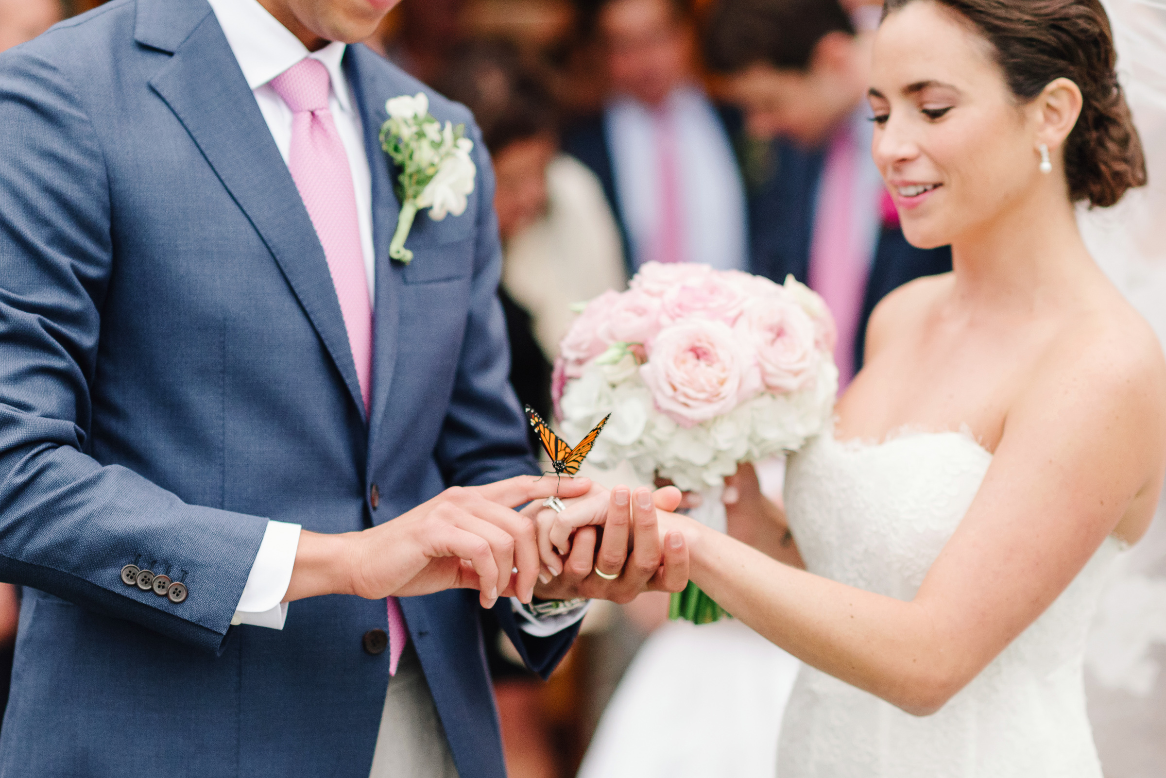 Butterfly lands on bride's finger during ring exchange - photo by Zofia & Co Photography - Nantucket