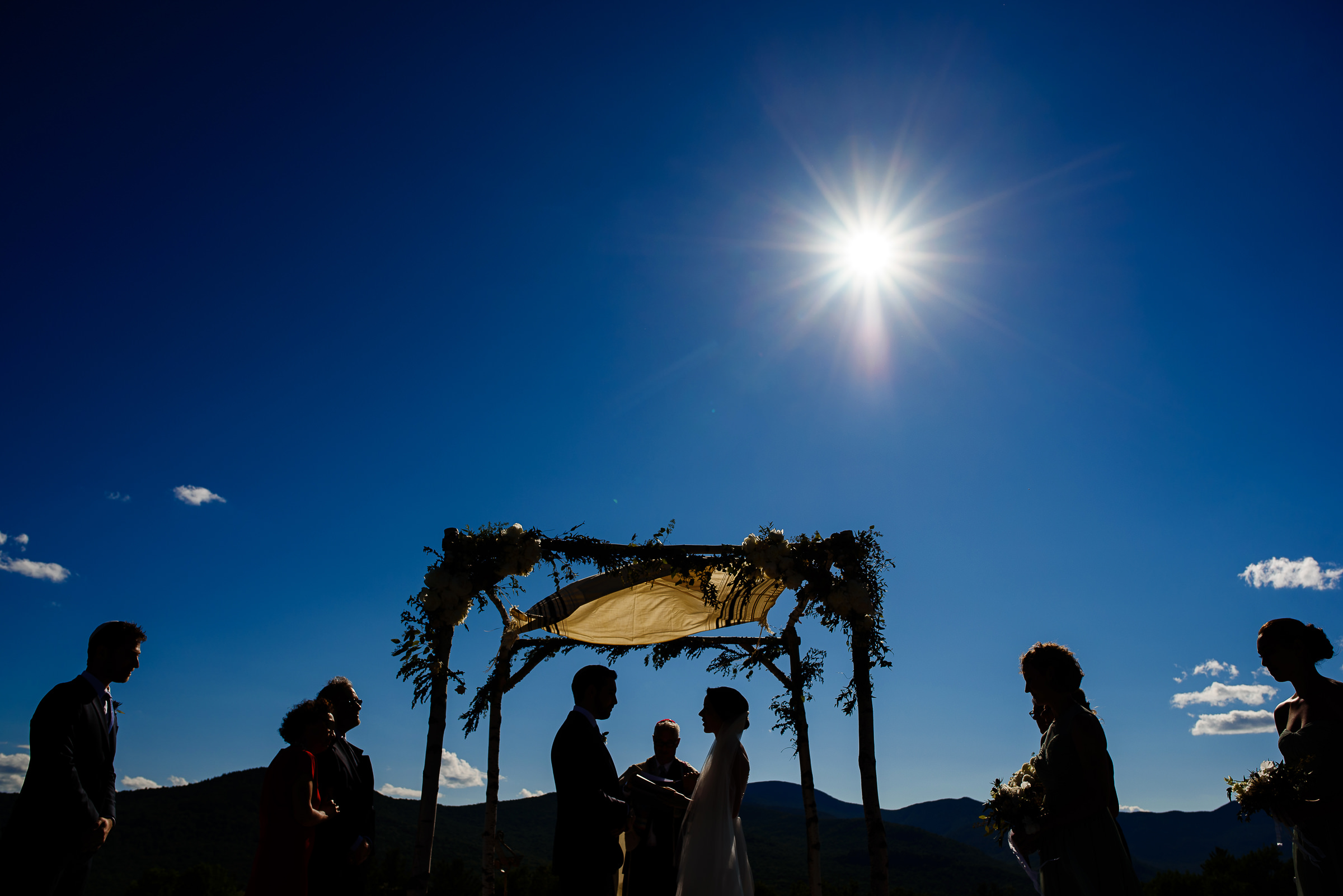 bride and groom exchanging vows under the chuppah- photo by Hannah Photography