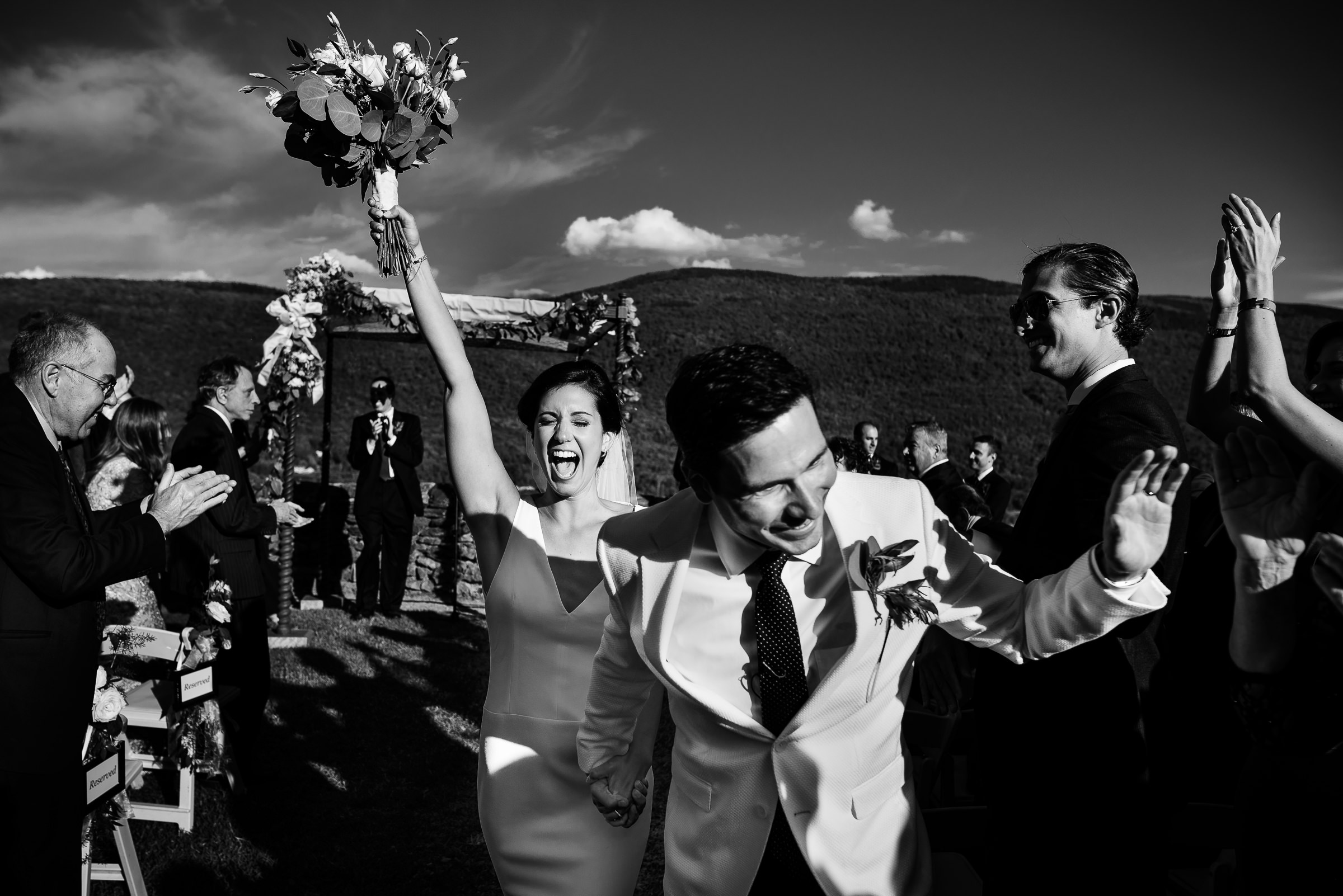 bride and groom happily leaving the ceremony after they got married- photo by Hannah Photography