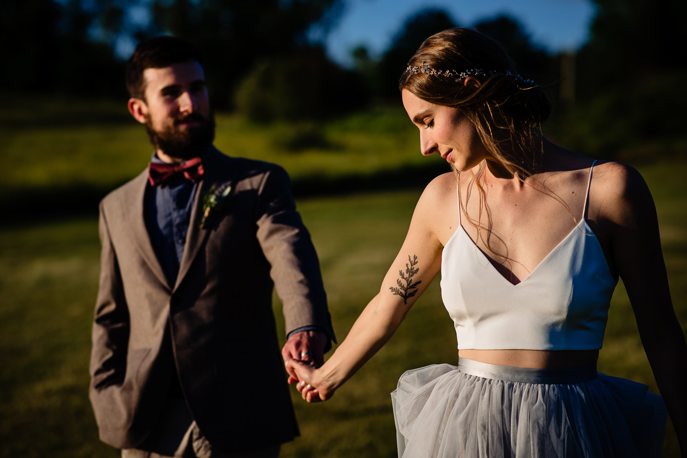 bride and groom holding hands enjoying time together- photo by Hannah Photography