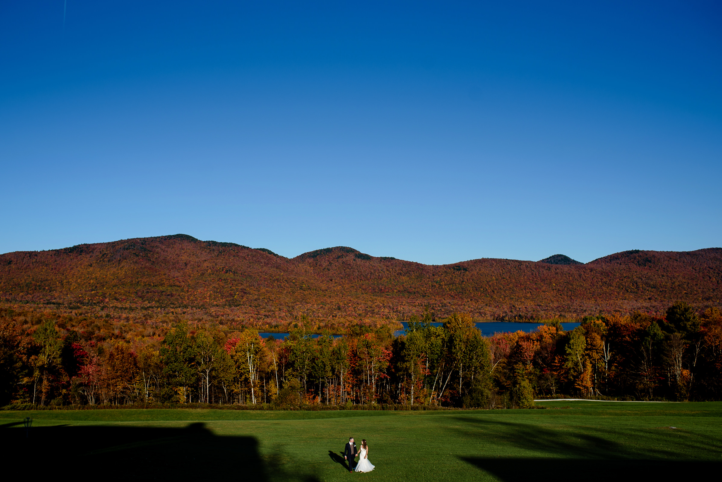 bride and groom portrait in the fall colors with mountain behind- photo by Hannah Photography