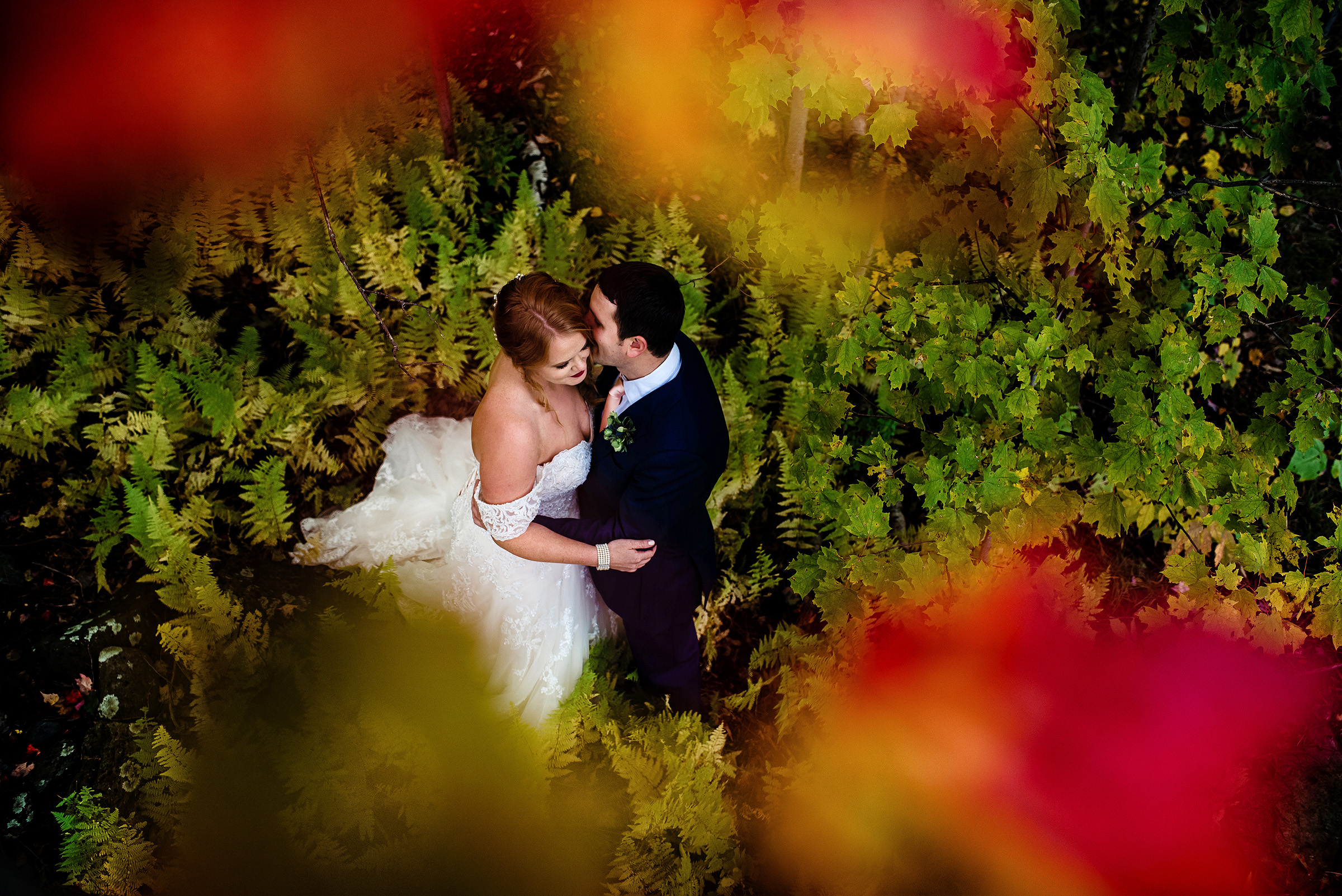 bride and groom portrait under the colorful fall leaves- photo by Hannah Photography