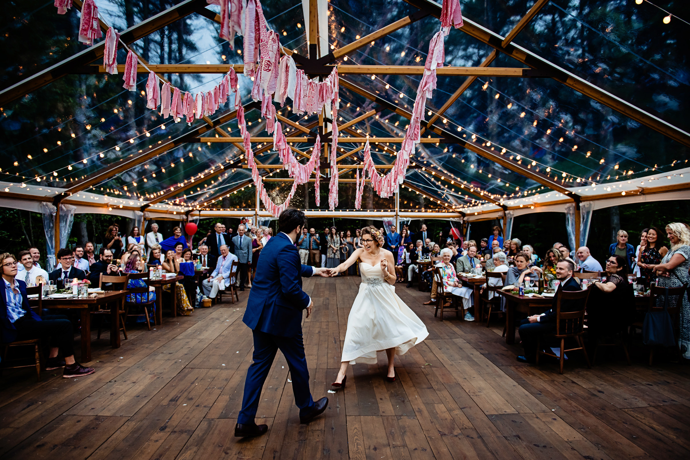 bride and grooms first dance under a glass tent among the stars - photo by Hannah Photography