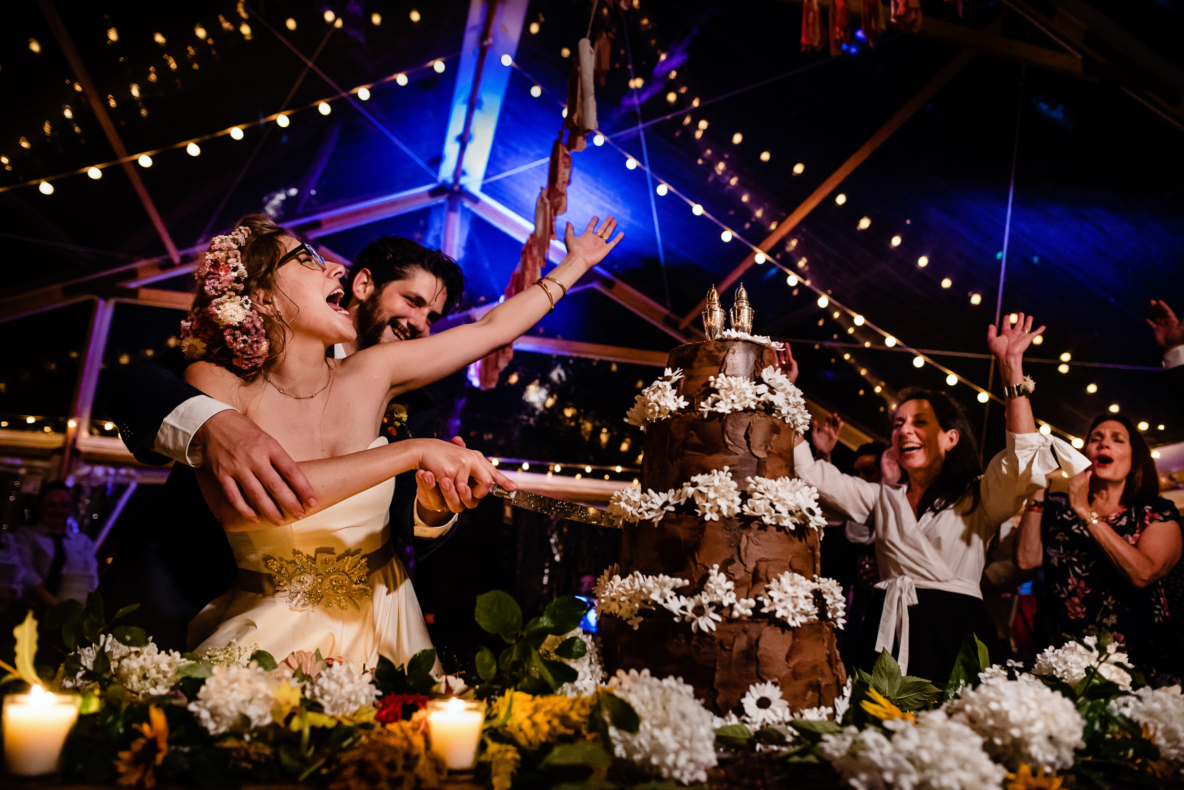 crazy fun bride and groom cake cutting - photo by Hannah Photography