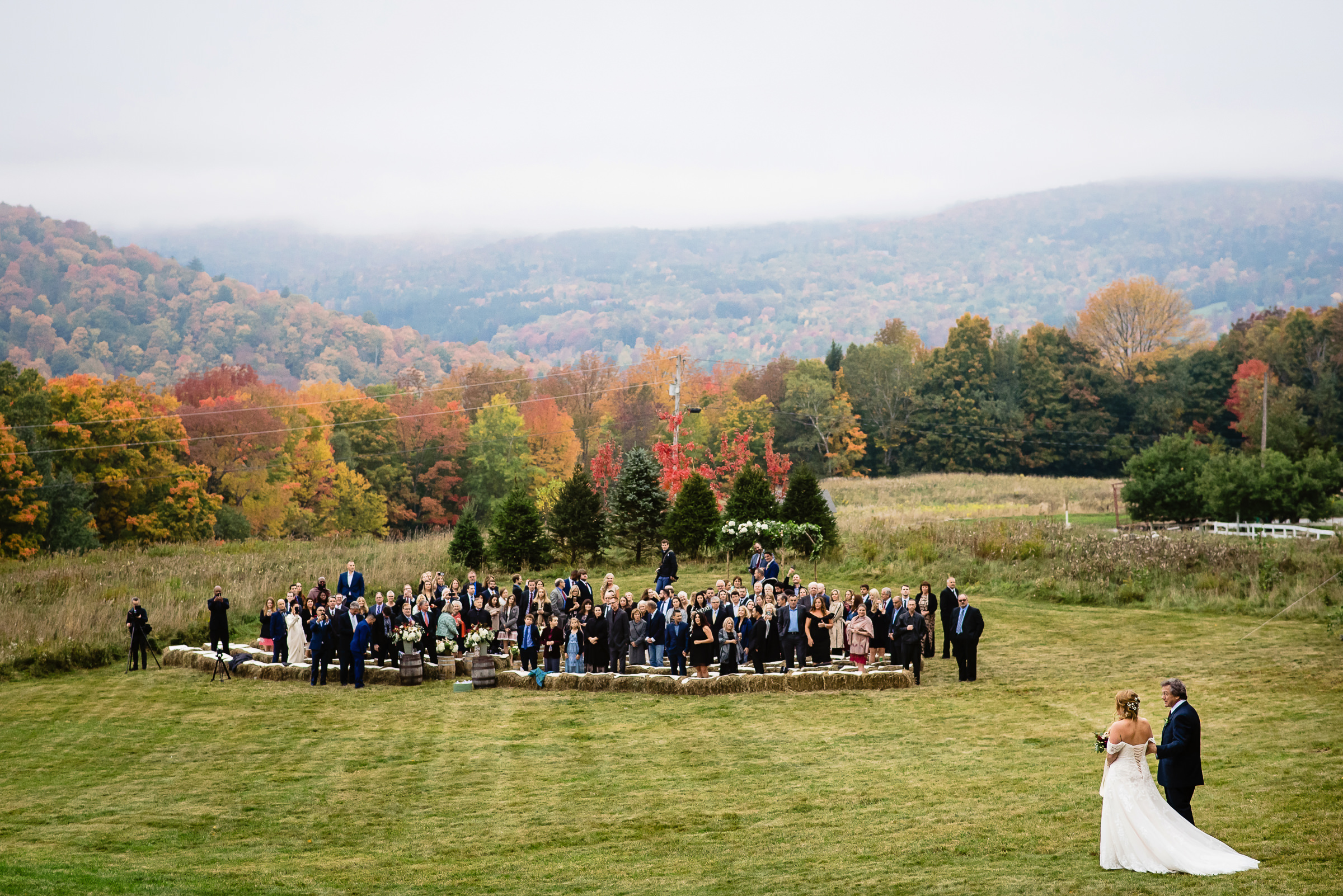 dad getting ready to walk bride down the aisle in the colorful fall mountains- photo by Hannah Photography