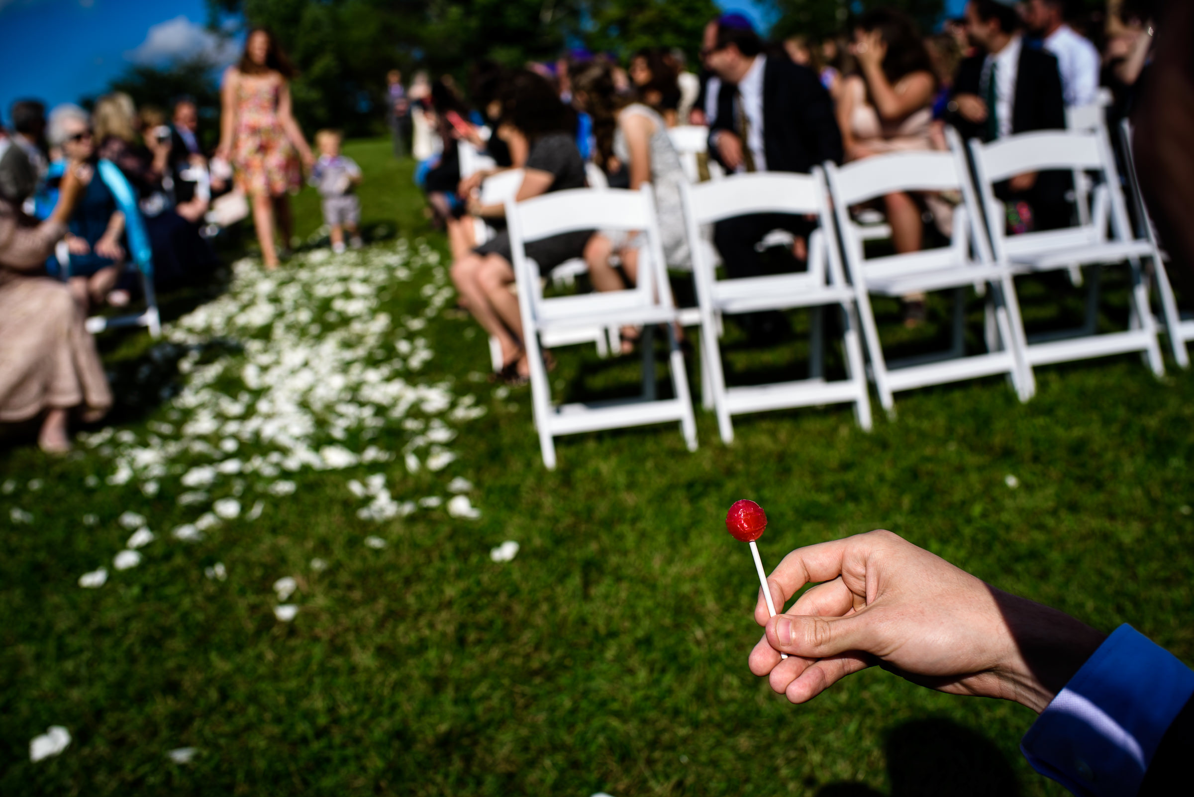 eating a lollipop while processional comes their way- photo by Hannah Photography