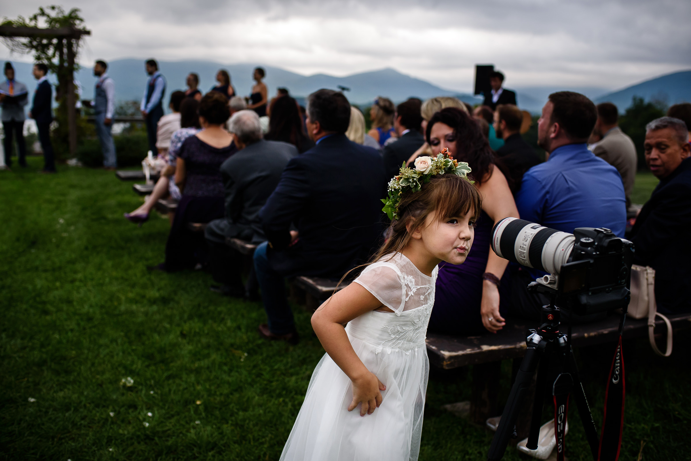 flower girl checking out the photographers lens during the ceremony- photo by Hannah Photography