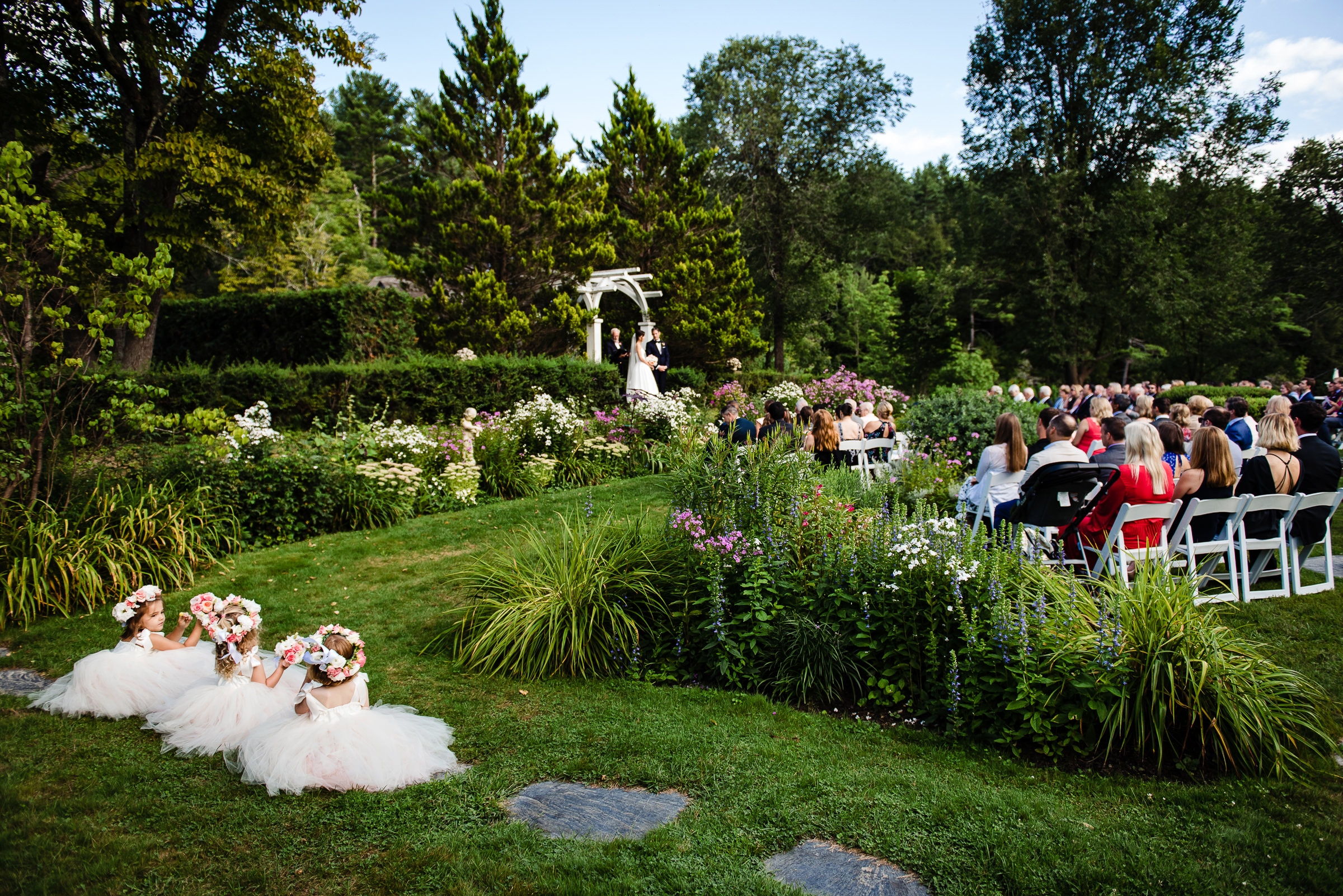 Flower girls chilling while ceremony is happening - photo by Hannah Photography