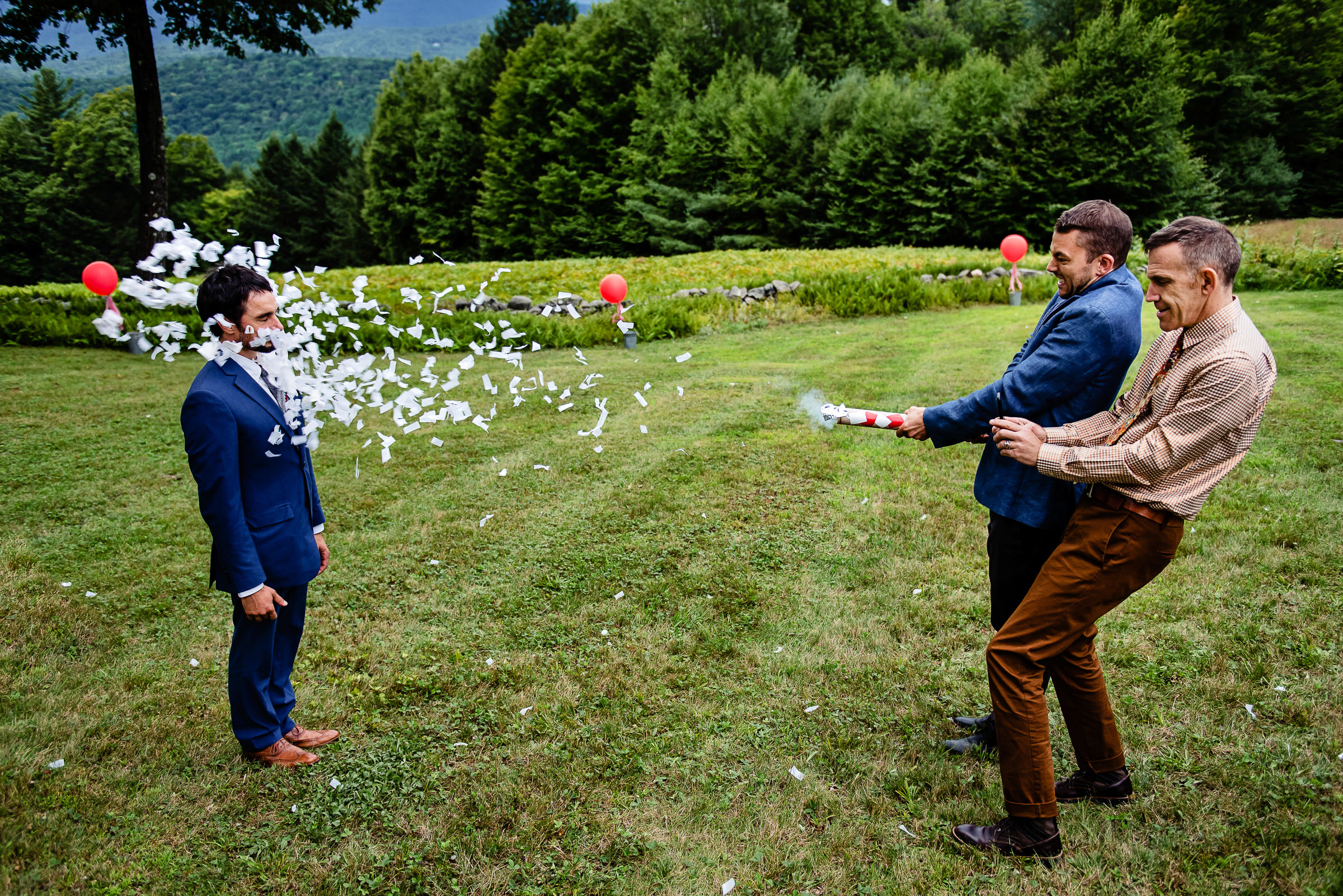 guests being playful with the groom - photo by Hannah Photography