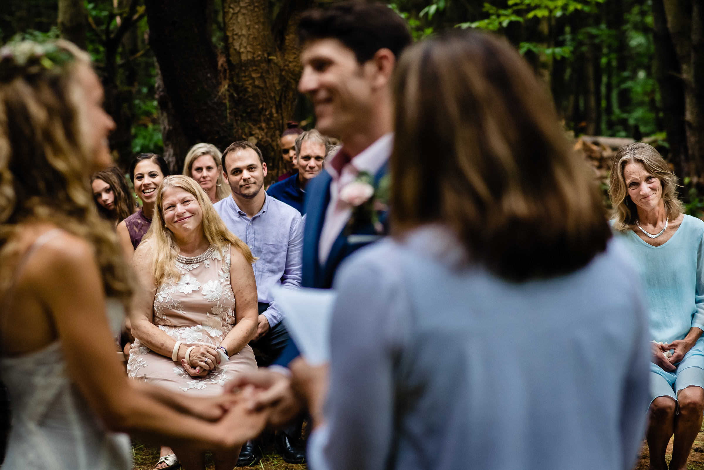 Moms smiling proudly during ceremony - photo by Hannah Photography