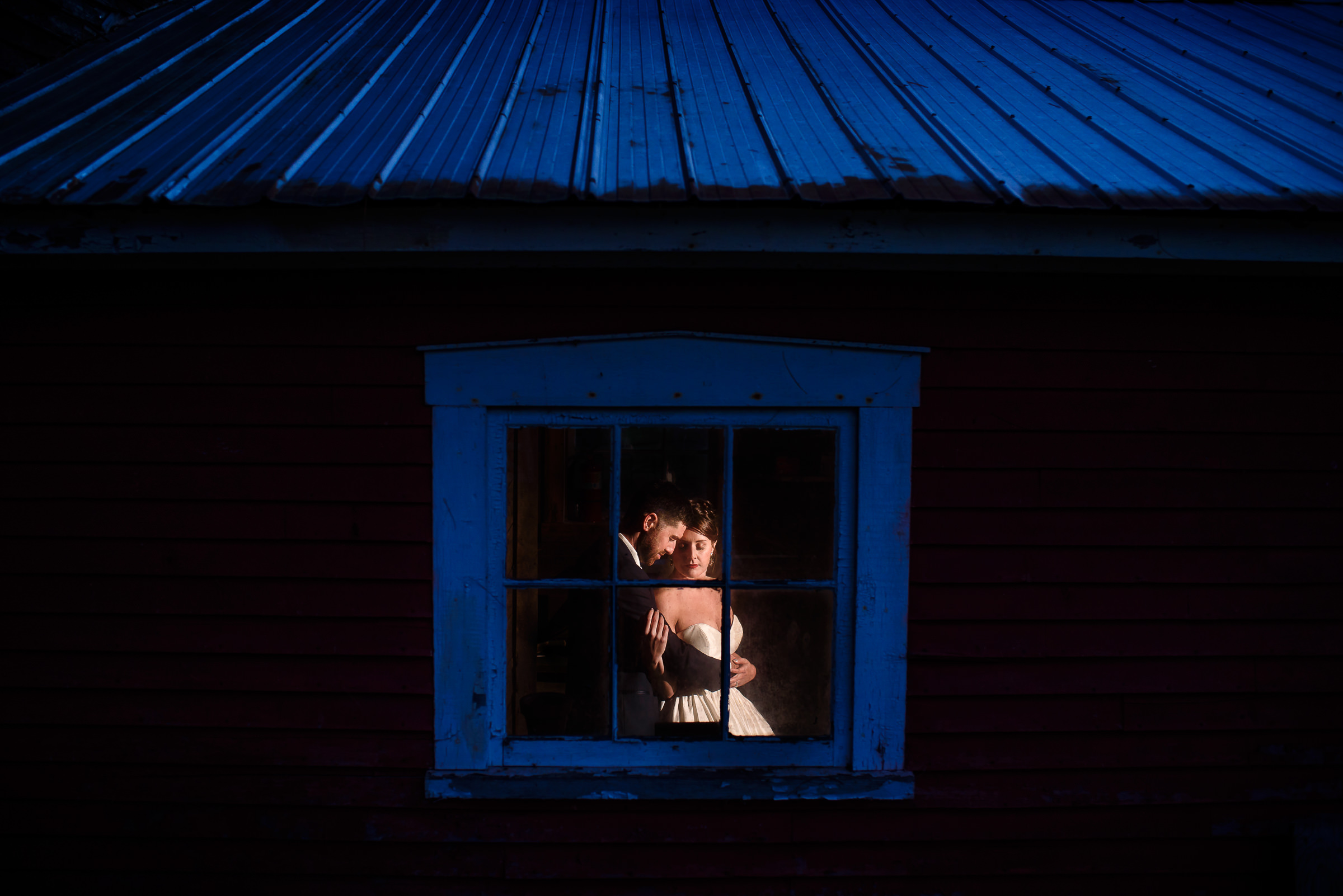 twilight bride and groom window portrait- photo by Hannah Photography