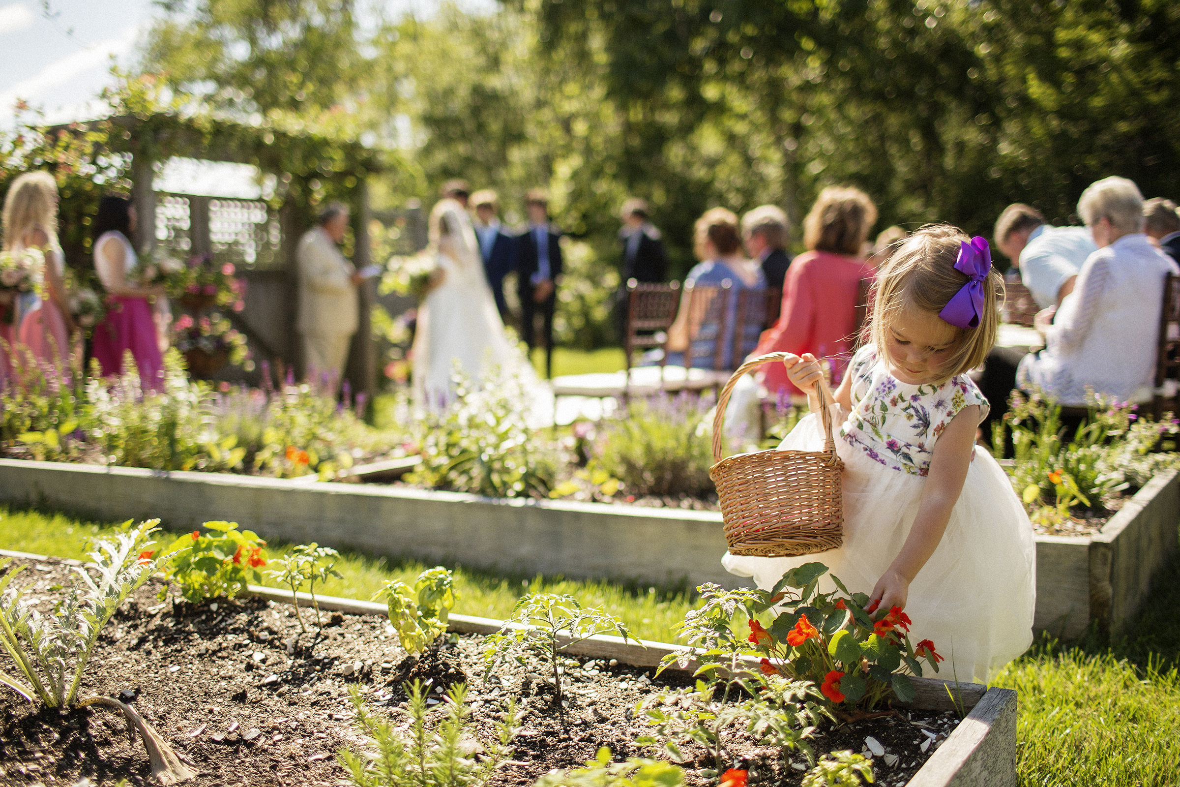 Little girl with basket near outdoor ceremony - photo by Joshua Behan Photography LLC