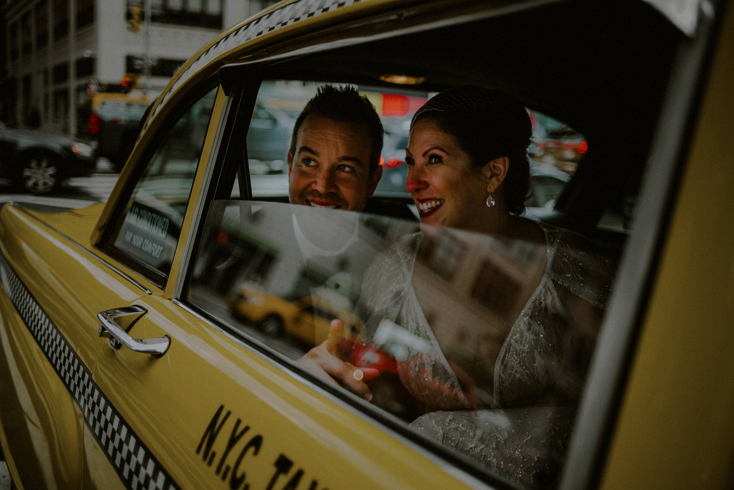 Couple exist in checker cab - photo by Carolina Rivera Photography