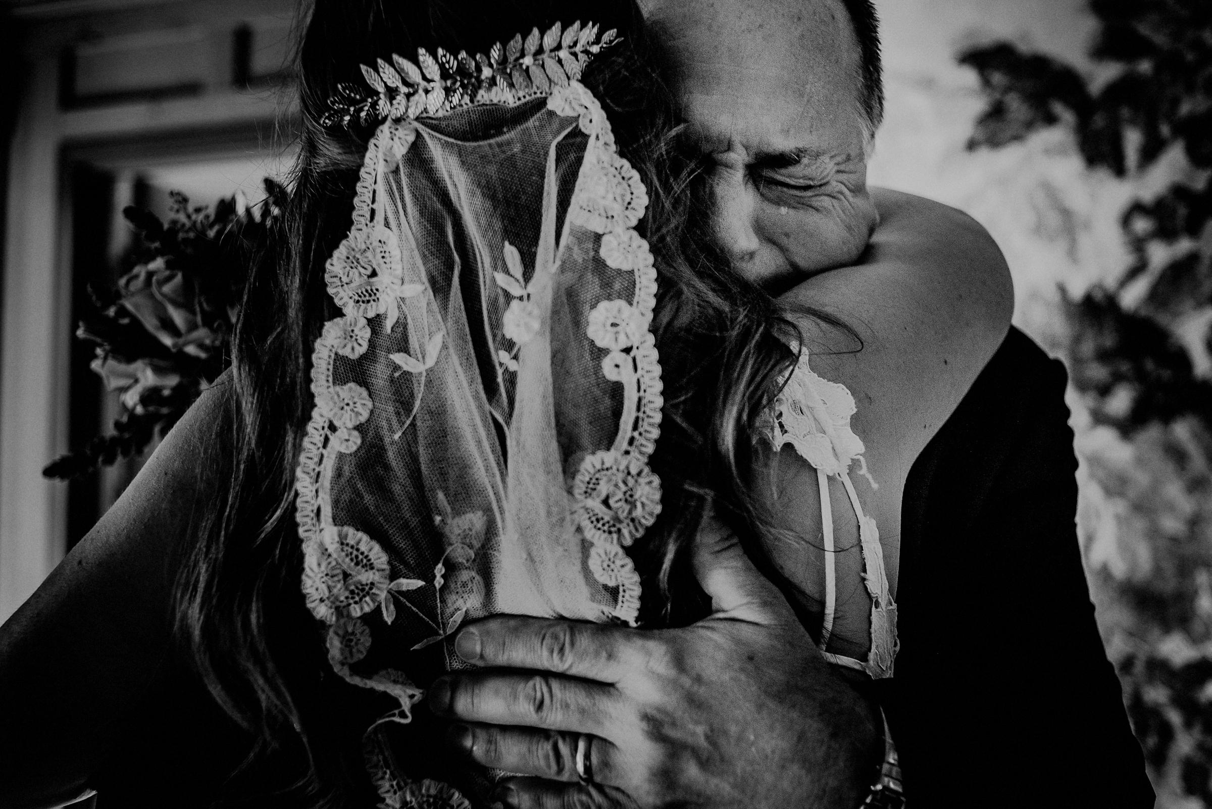 Emotional father embracing bride - photo by Carolina Rivera Photography