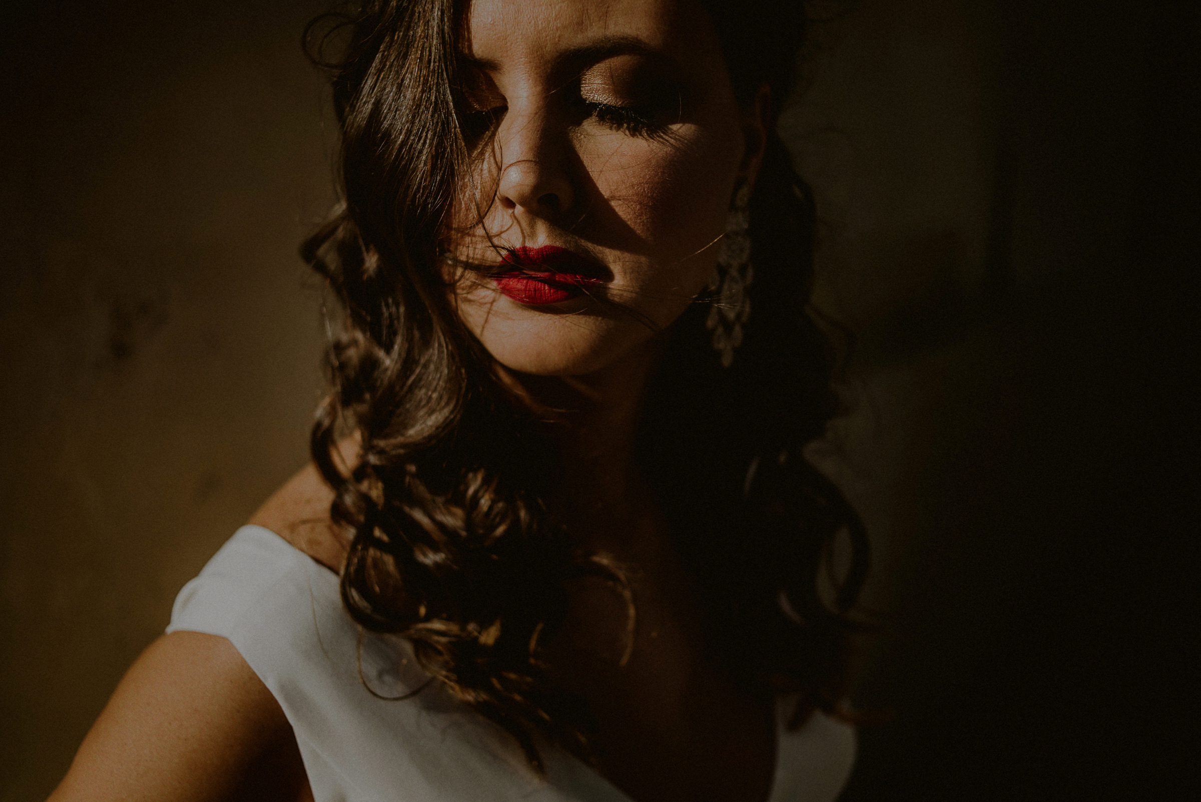 Shadowy closeup of bride - photo by Carolina Rivera Photography
