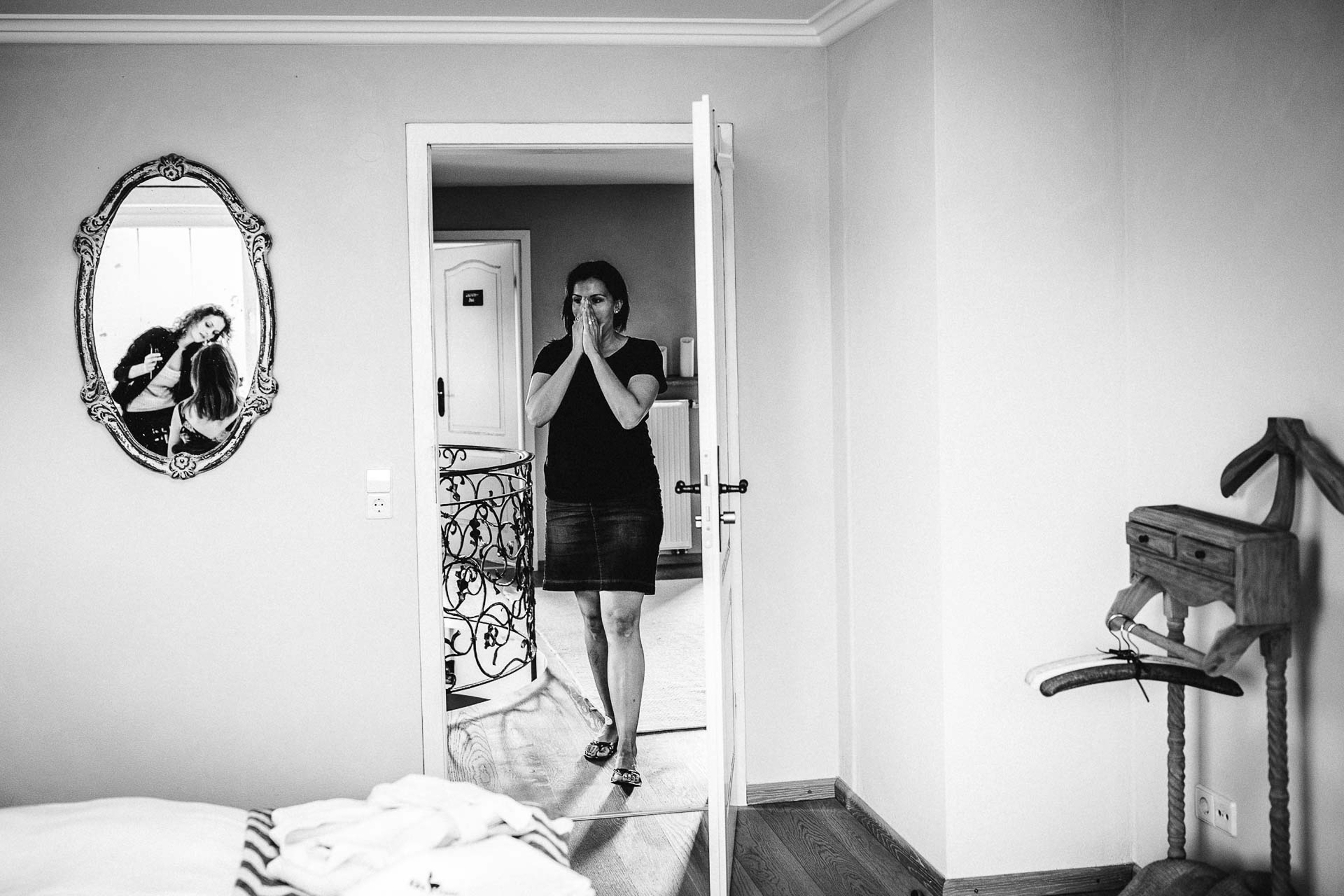 best friend seeing bride for the first time while getting makeup on - photo by FineArt Weddings | Photography
