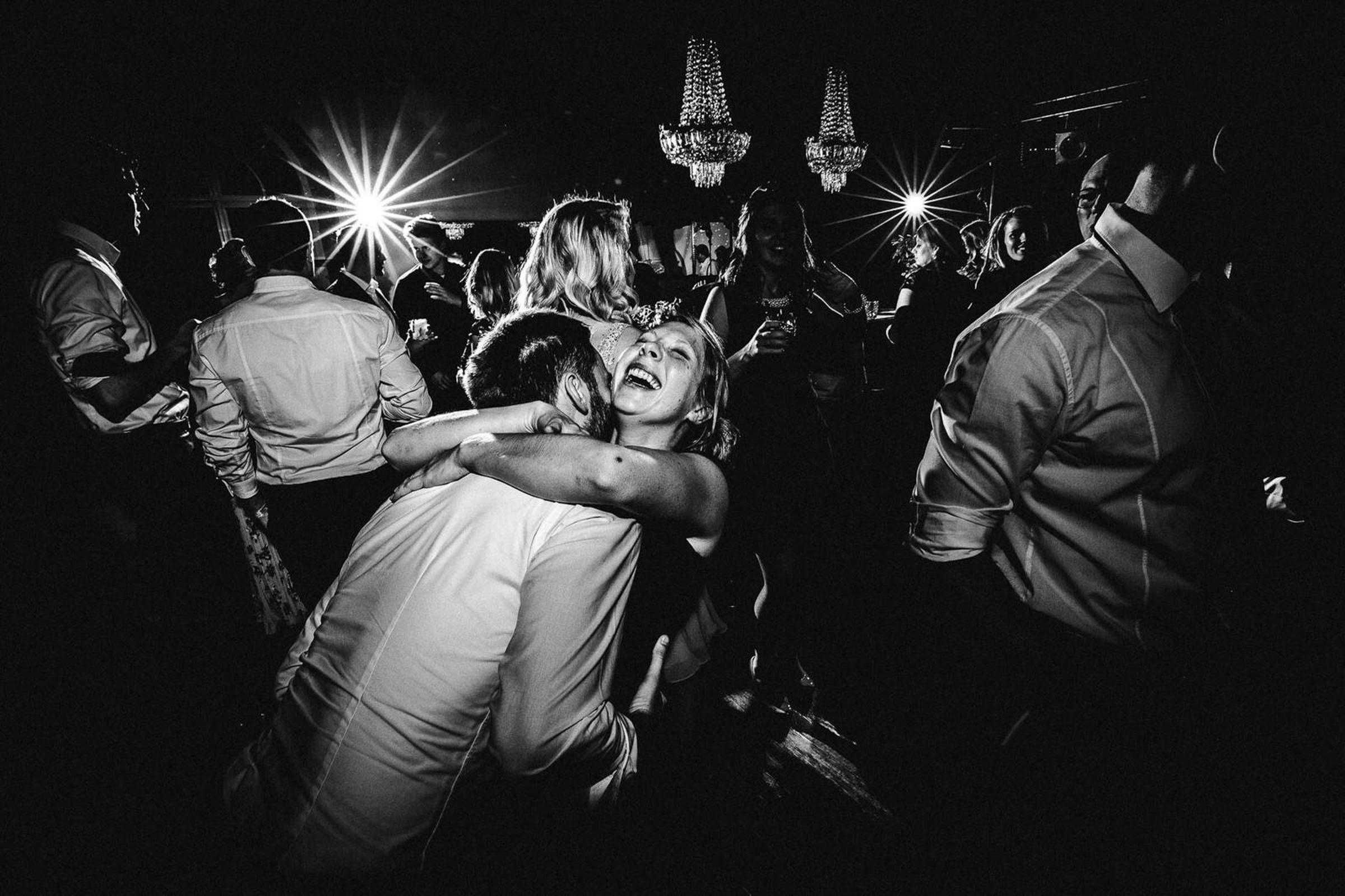 bride and groom hugging tightly on dance floor- photo by FineArt Weddings | Photography
