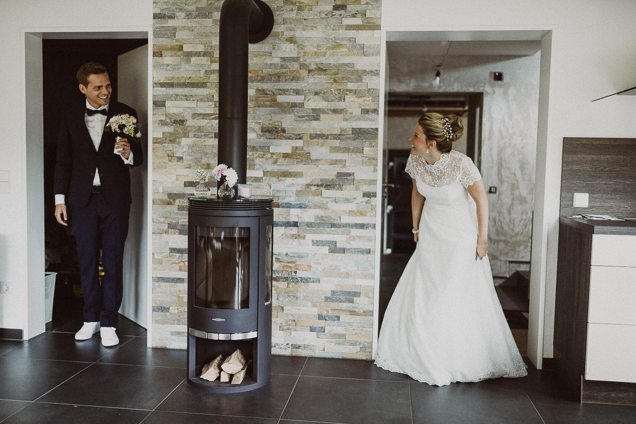 Bride and groom peekaboo in cabin - photo by FineArt Weddings | Photography