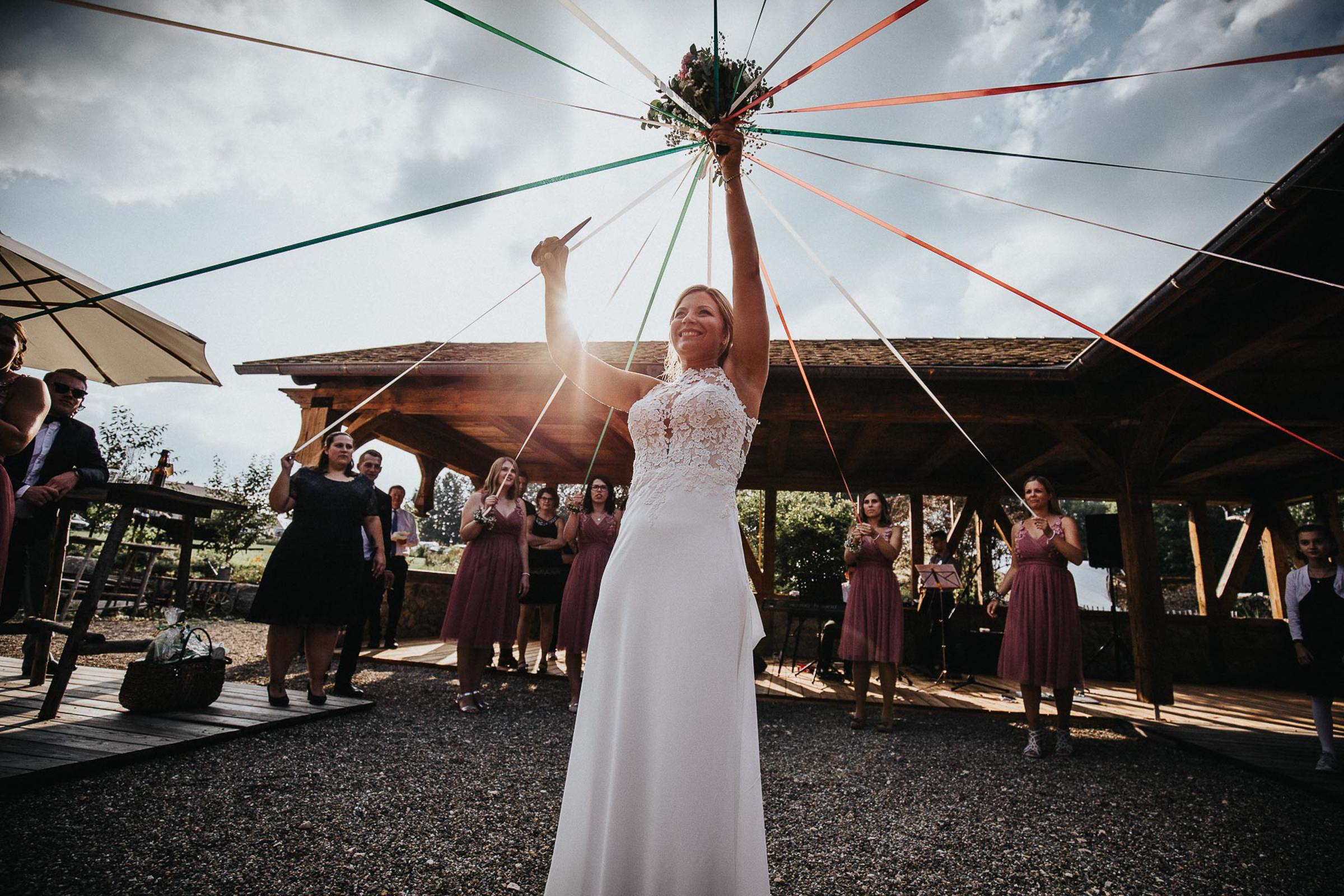 bride getting ready to toss bouquet- photo by FineArt Weddings | Photography
