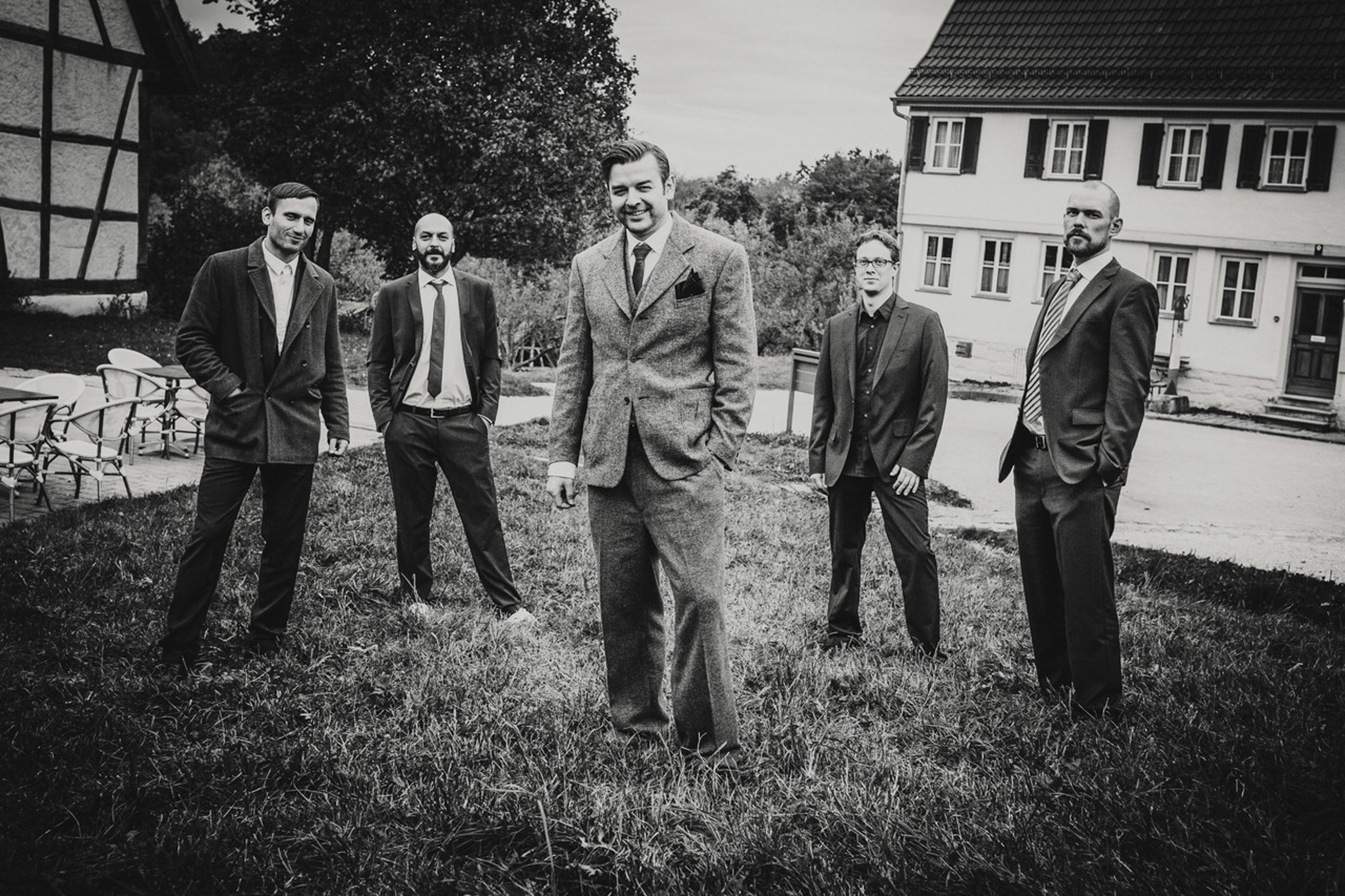 groom and groomsmen black and white portrait- photo by FineArt Weddings | Photography