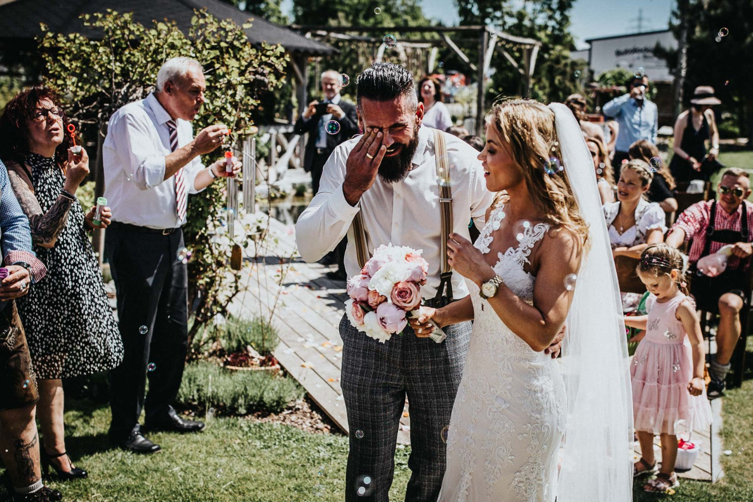 happy crying groom with bride at ceremony- photo by FineArt Weddings | Photography