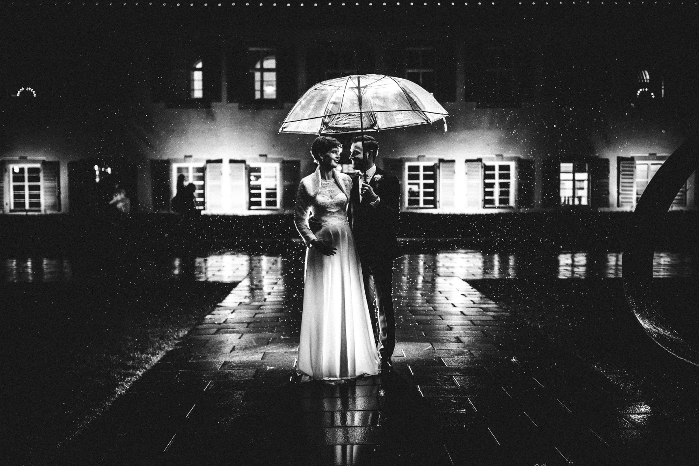 rainy bride and groom moment under umbrella- photo by FineArt Weddings | Photography