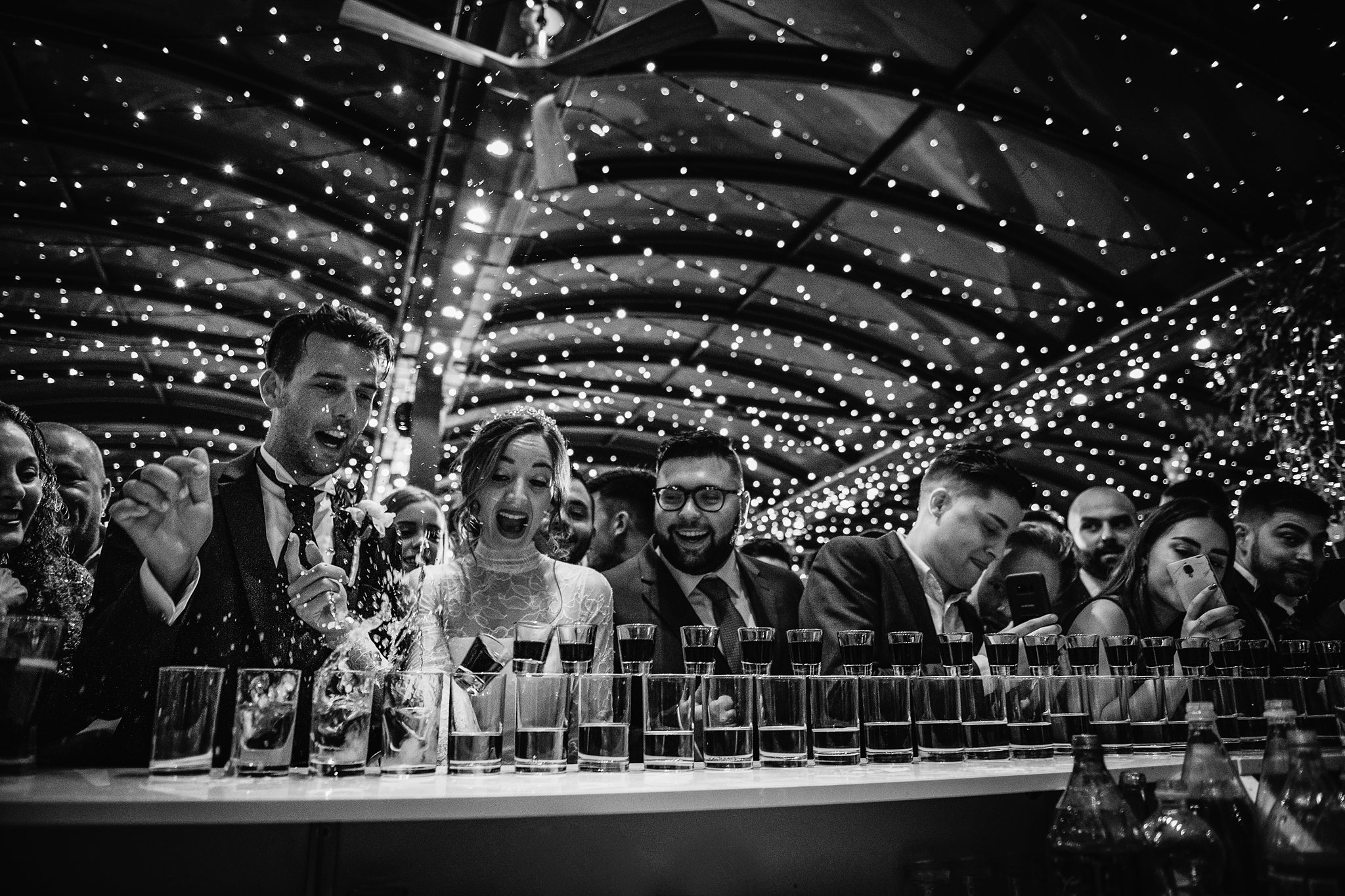 bride and groom doing shots with friends- photo by Shane P Watts Photography