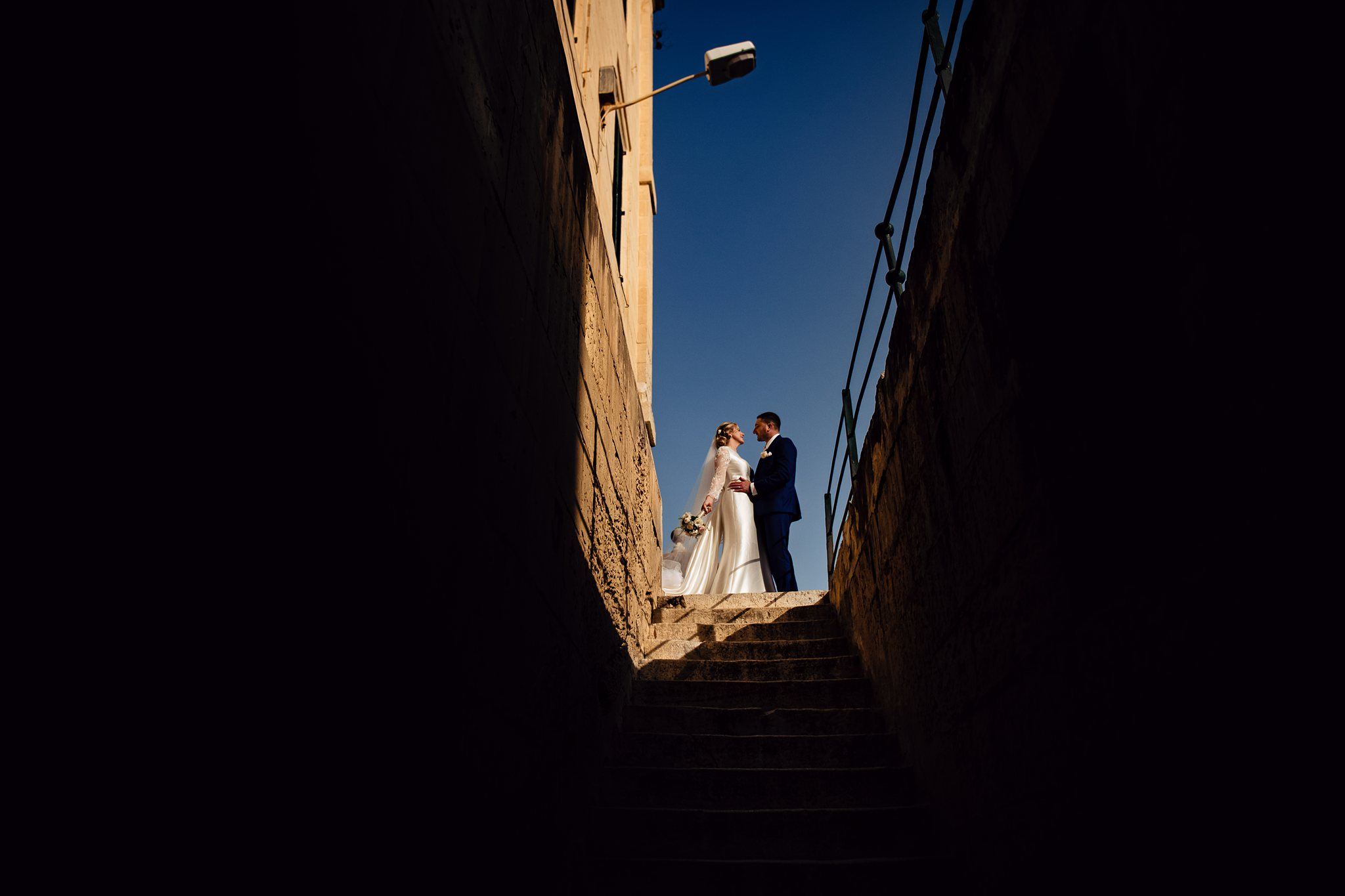 bride and groom having a moment together in beautiful light- photo by Shane P Watts Photography