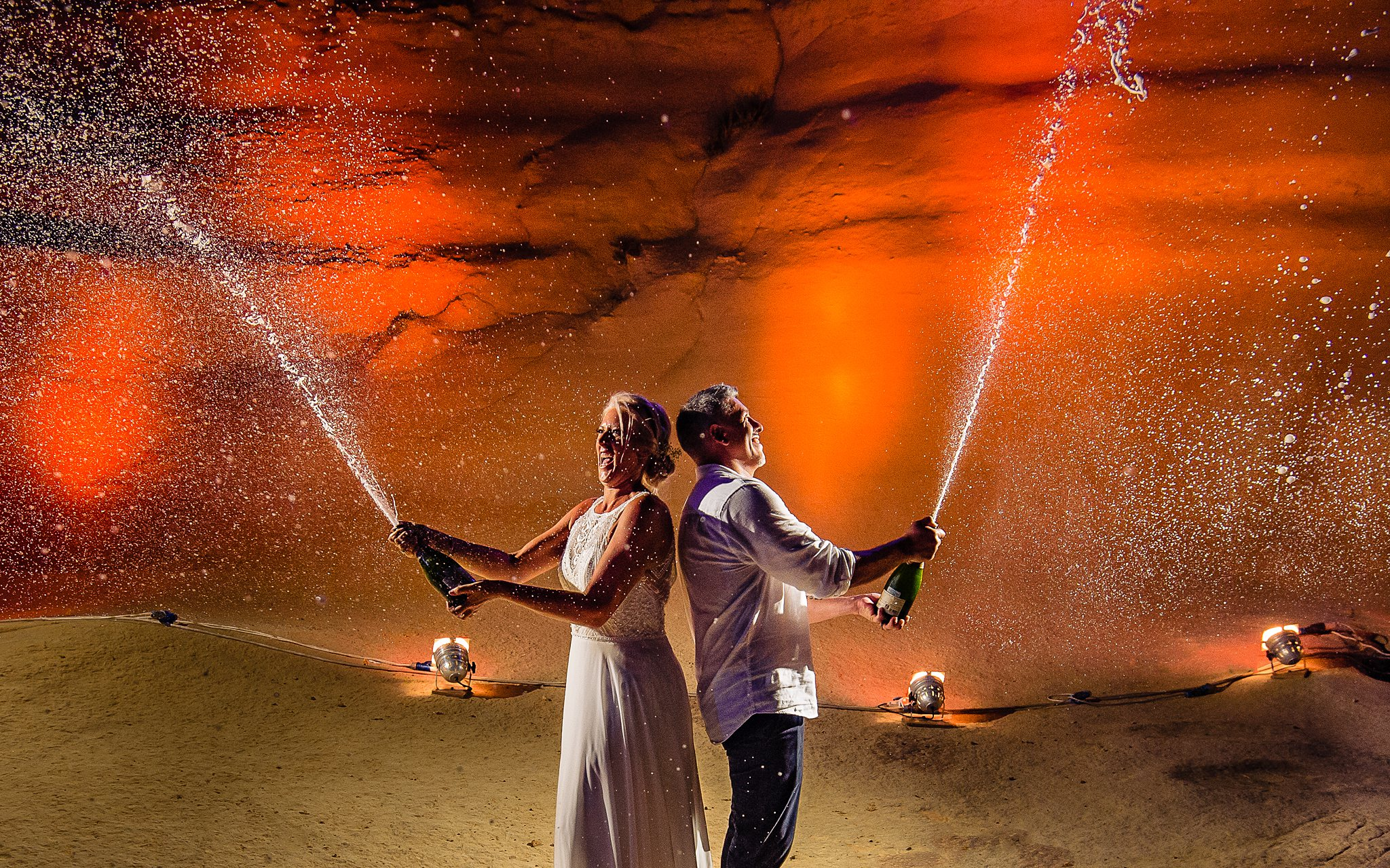 bride and groom popping champagne simultaneously- photo by Shane P Watts Photography