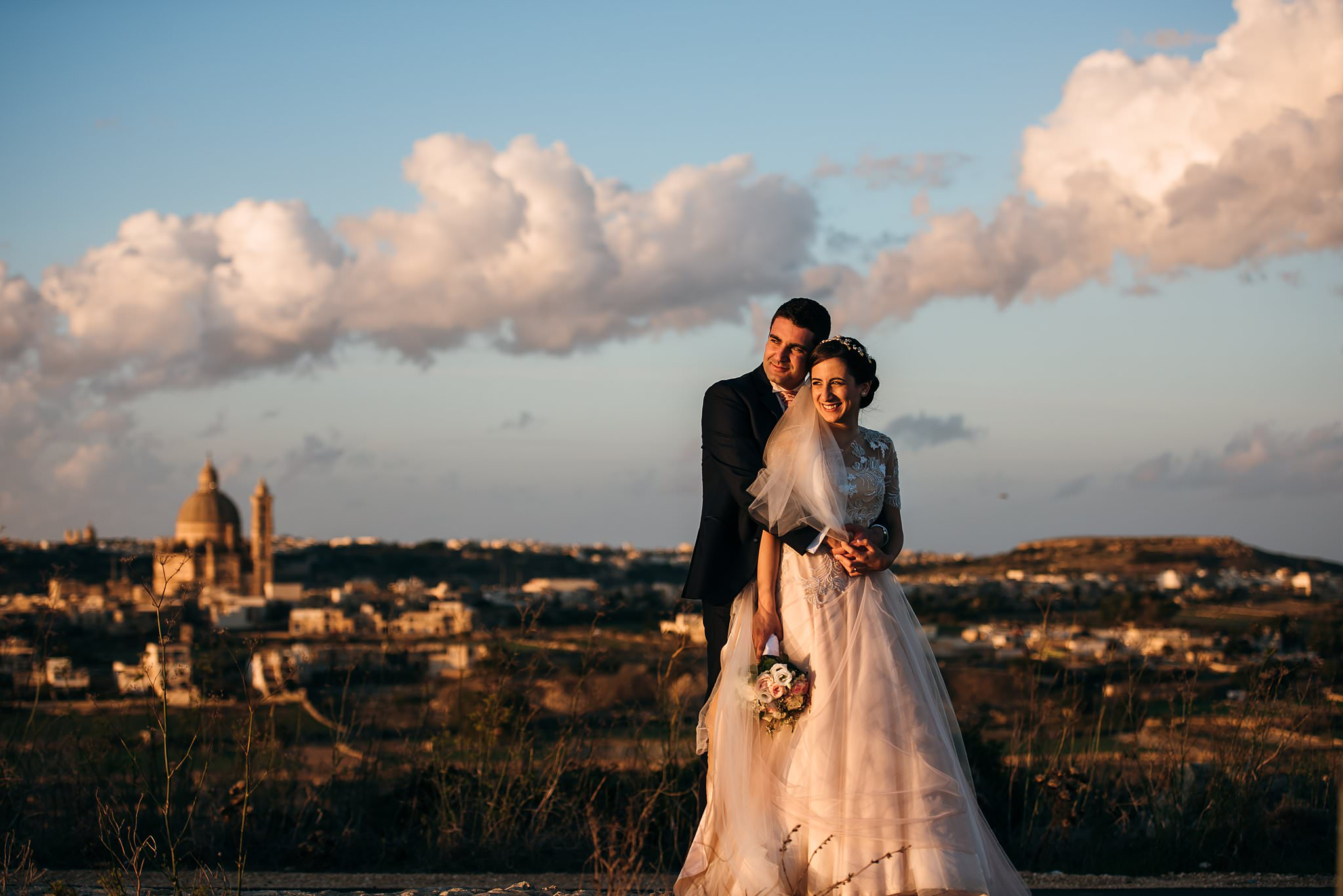 bride and groom portrait amongst the clouds- photo by Shane P Watts Photography