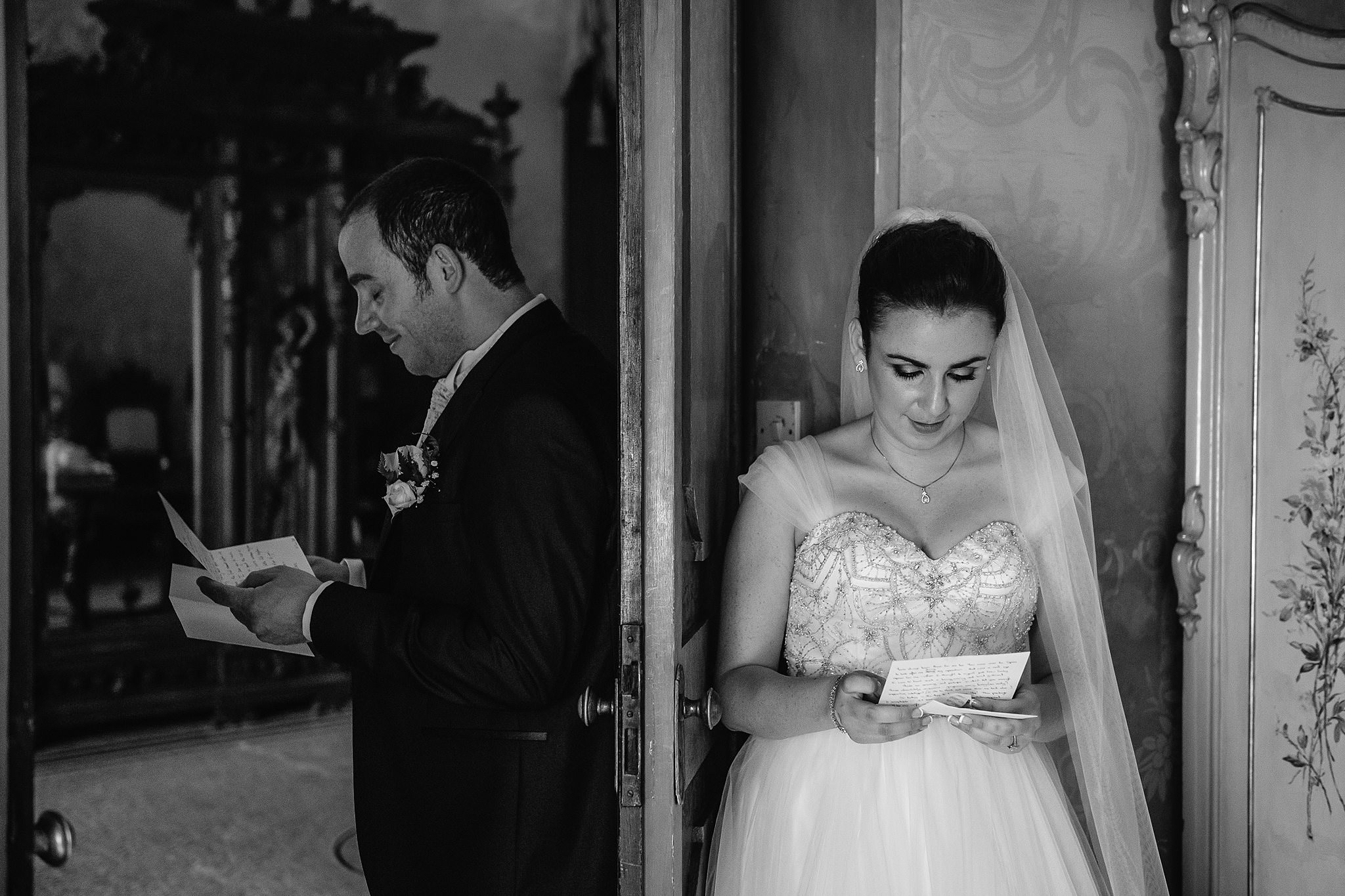 bride and groom reading sweet notes from each other before - photo by Shane P Watts Photography