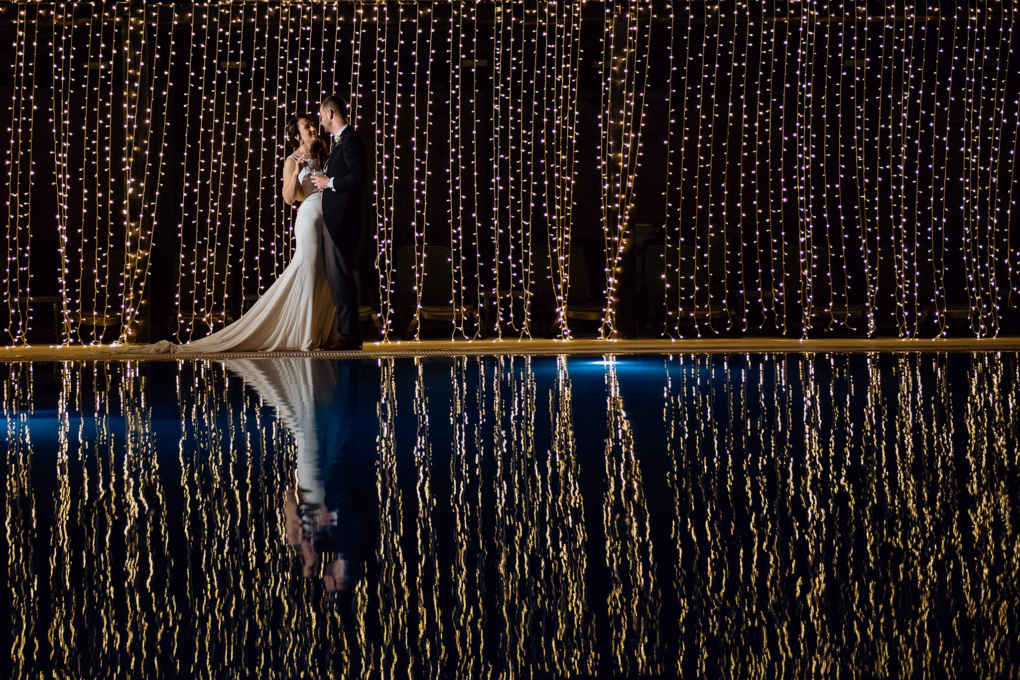bride and groom reflection portrait- photo by Shane P Watts Photography