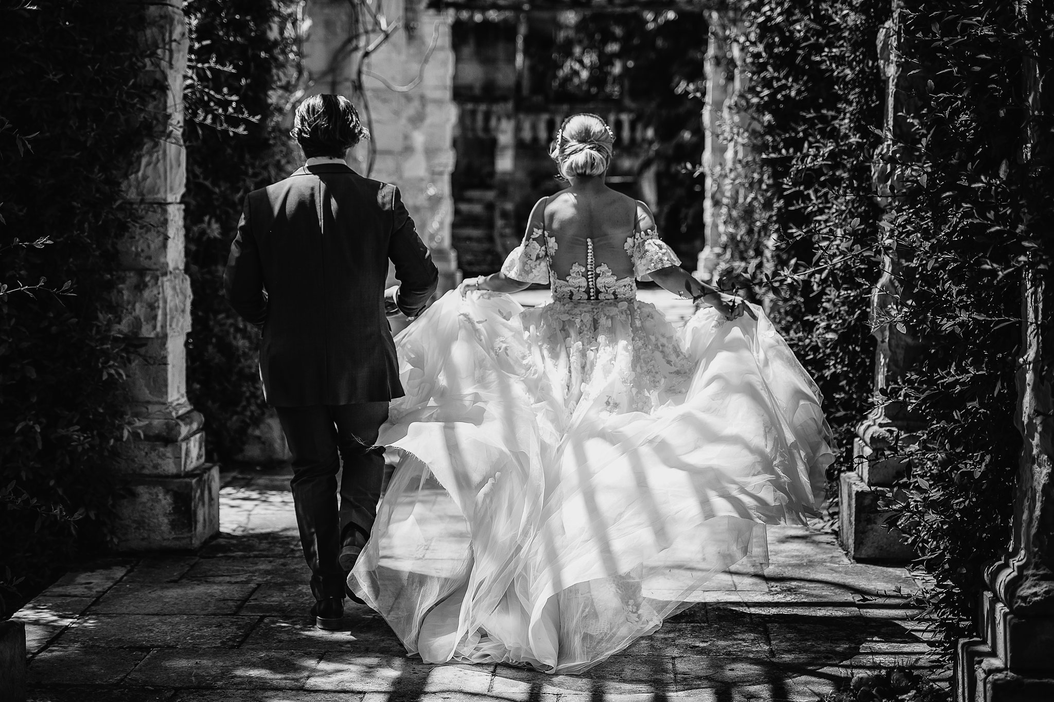 bride and groom walking together in sweet moment- photo by Shane P Watts Photography