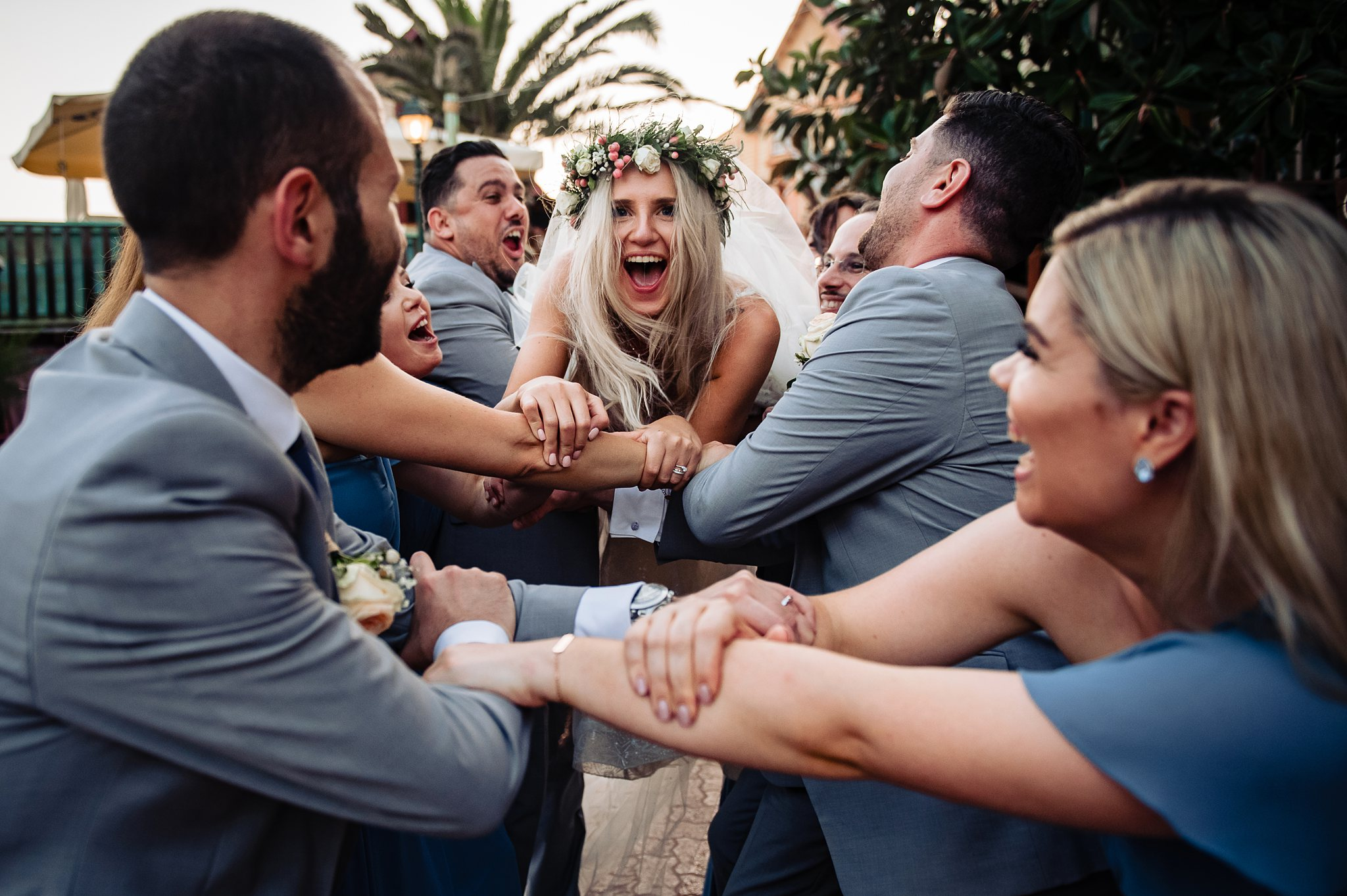 bride happily jumping into the arms of her guests- photo by Shane P Watts Photography