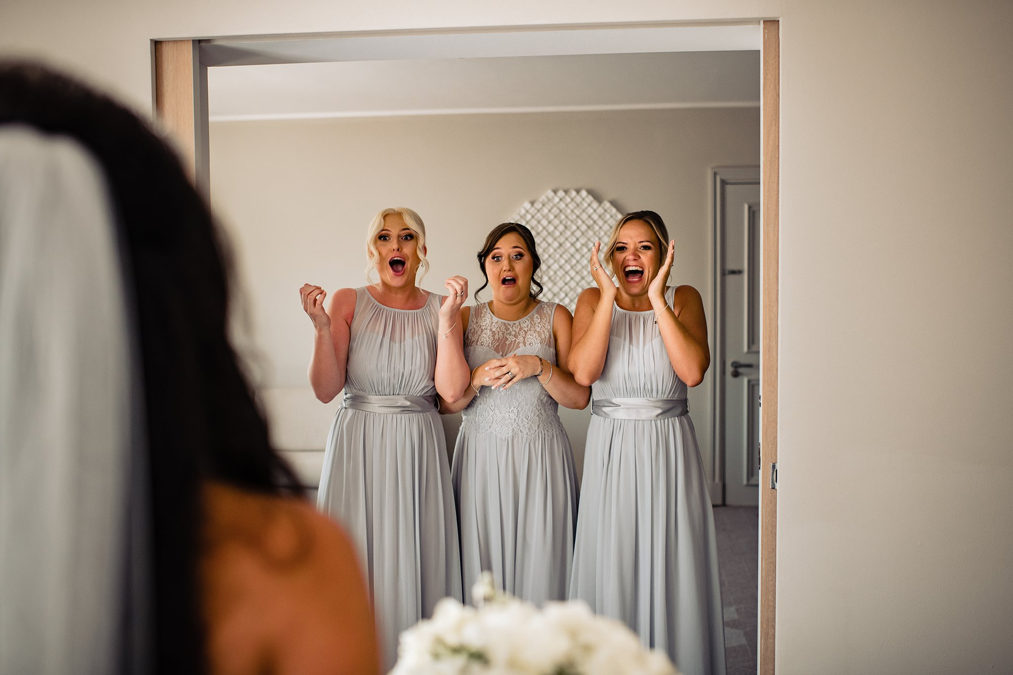 bridesmaids excited to see the bride for the first time- photo by Shane P Watts Photography