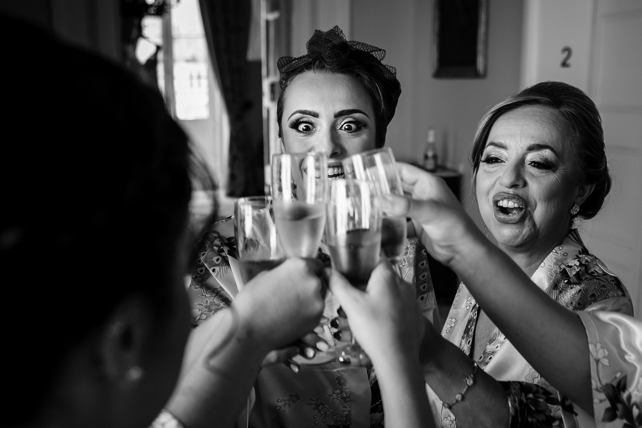 bridesmaids toast to the bride while getting ready- photo by Shane P Watts Photography