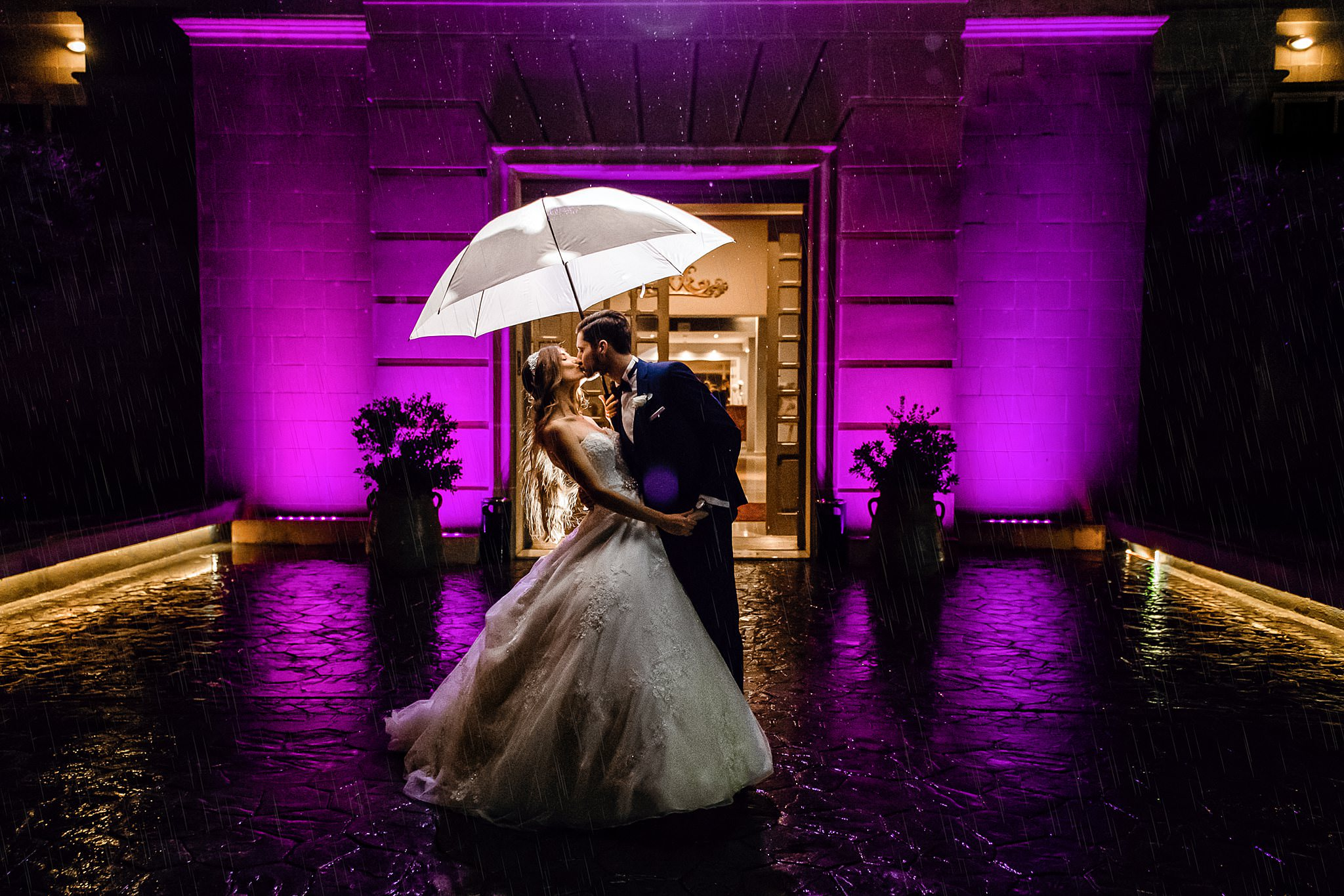 Couple kiss under lighted umbrella - photo by Shane P. Watts Photography