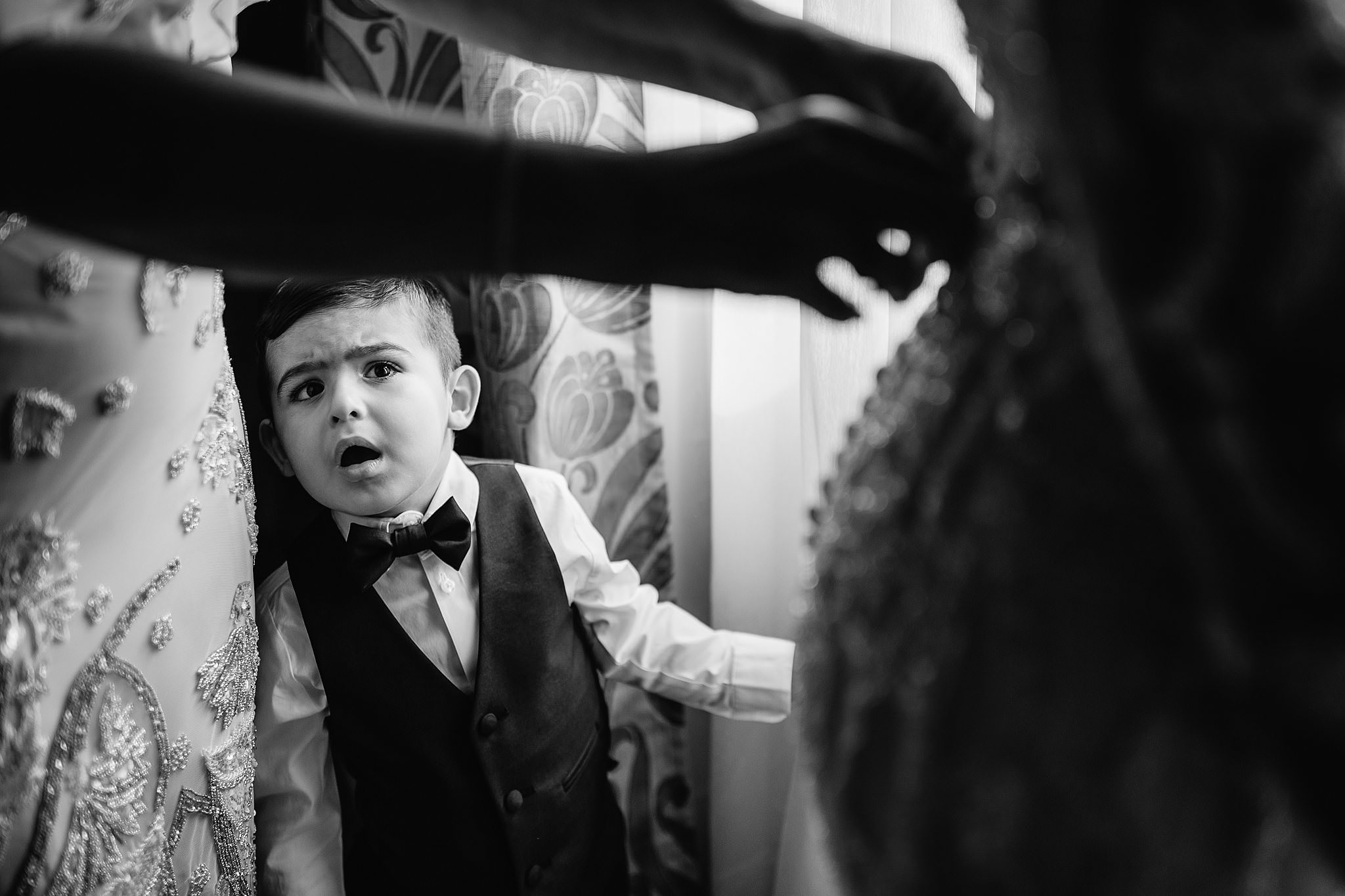 funny moment of little boy watching bride get her dress on- photo by Shane P Watts Photography