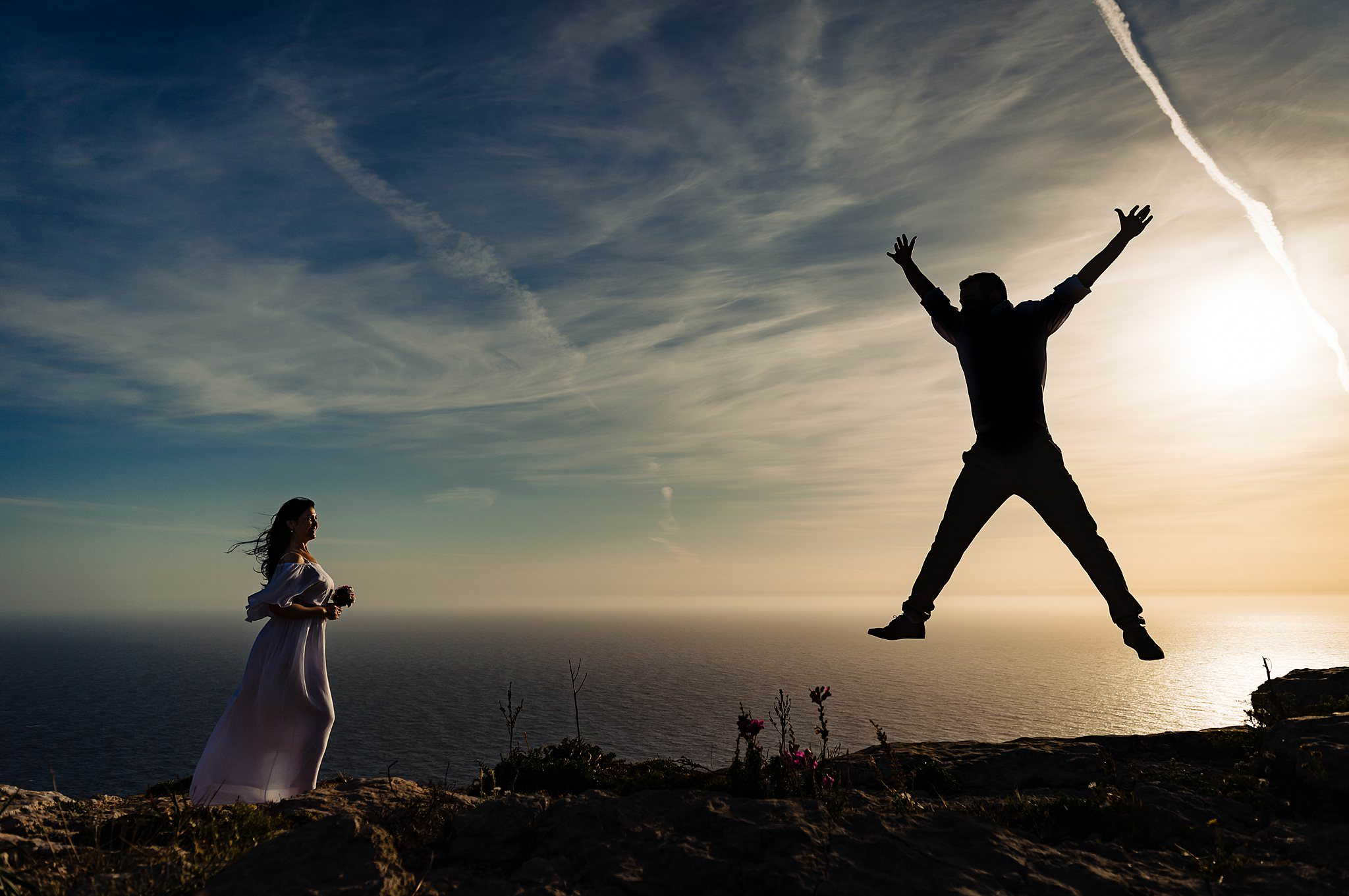 groom jumping in the air to entertain bride during portraits- photo by Shane P Watts Photography