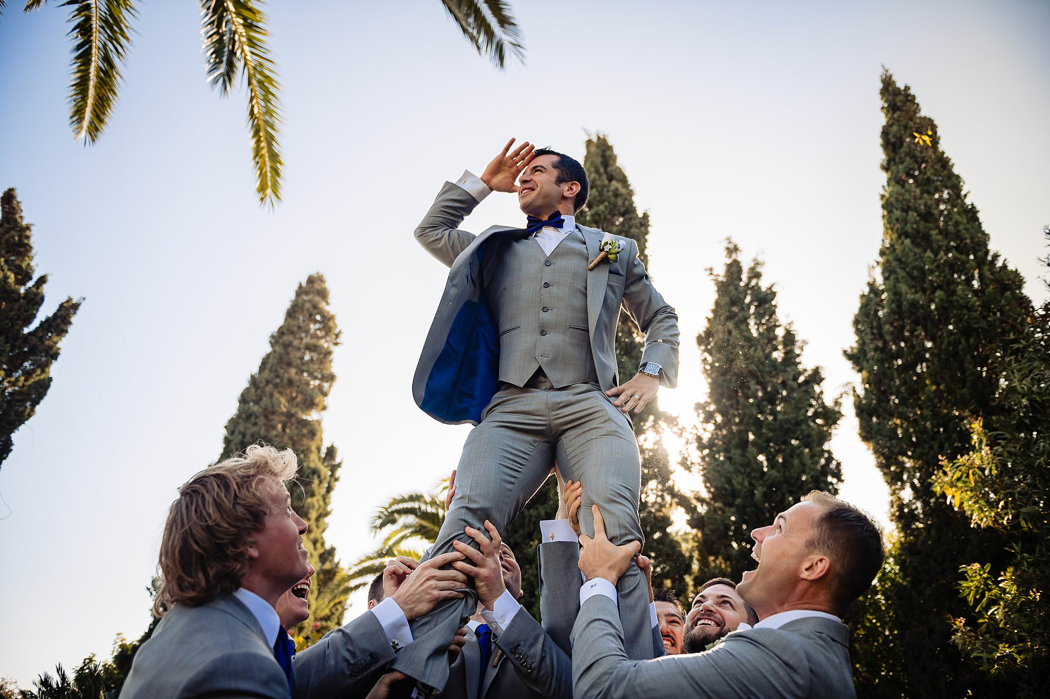 groomsmen having fun holding the groom in the air- photo by Shane P Watts Photography