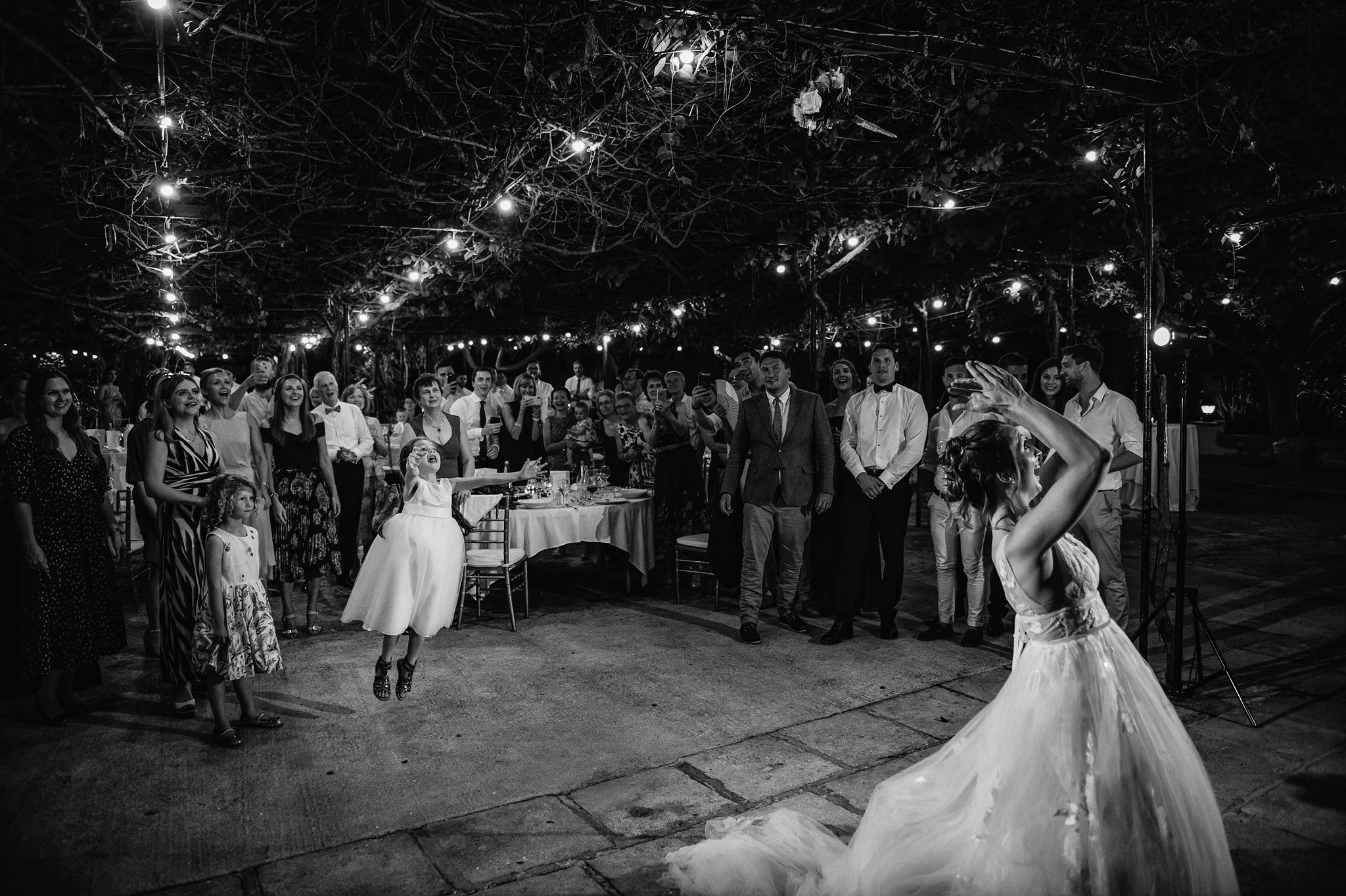 Little girl jumps into the air to catch bouquet - photo by Shane P. Watts Photography